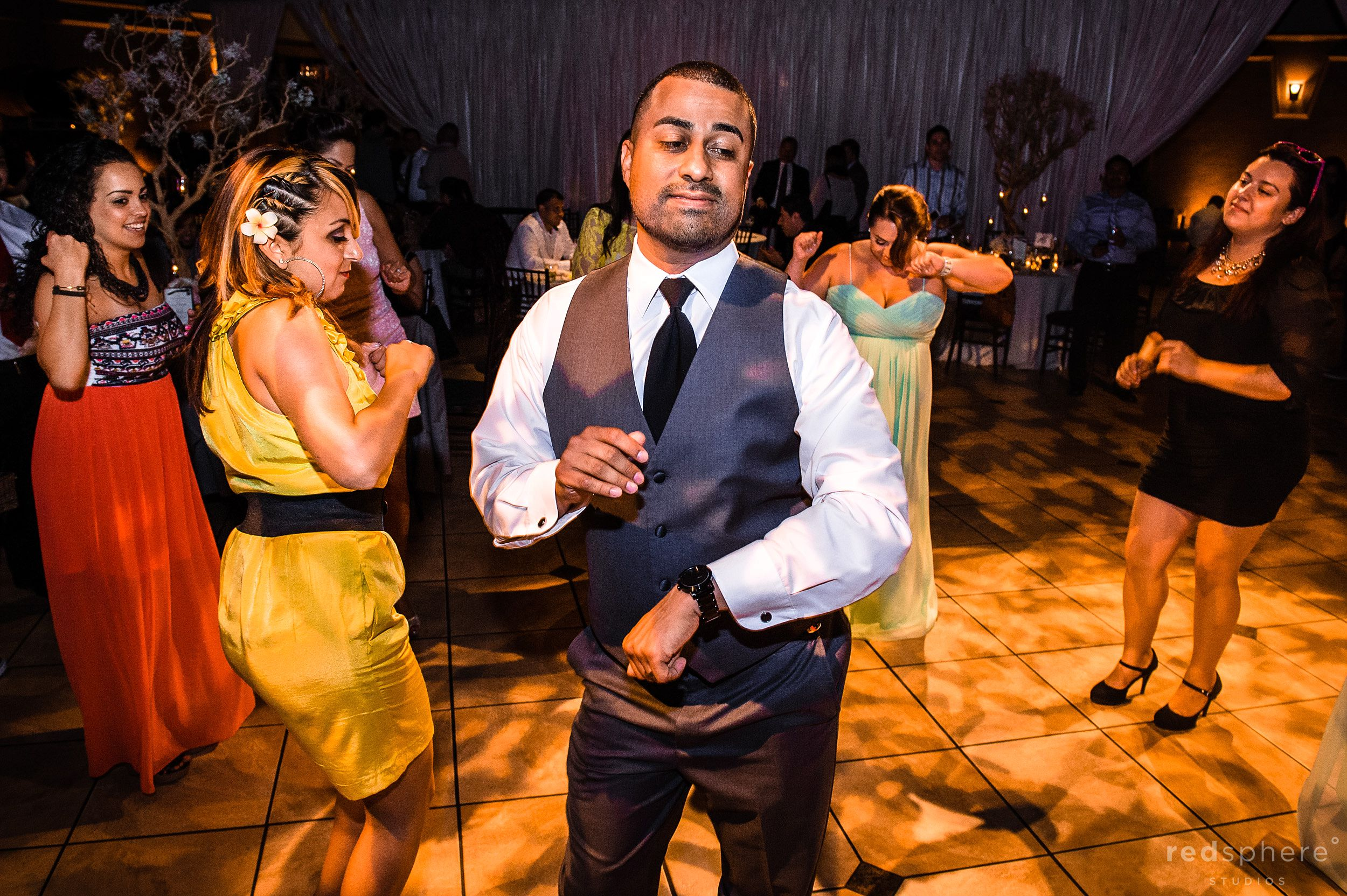 Groom Dancing to the Music at Palm Event Center Wedding Reception