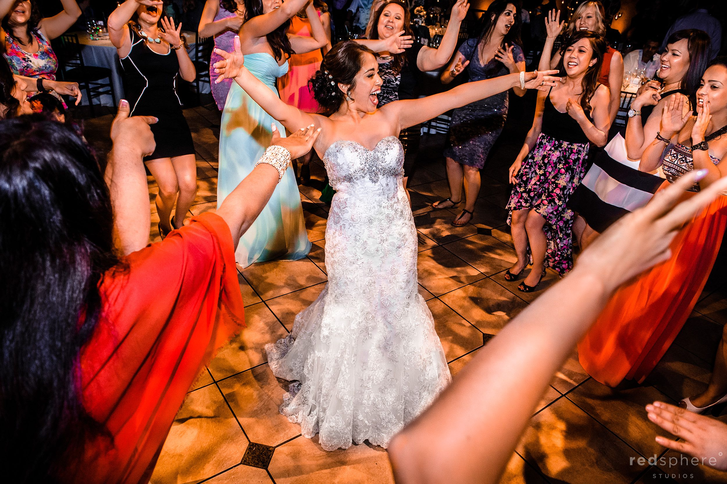 Bride Dances in Spotlight While Being Surrounded by Close Friends and Family at Wedding Reception