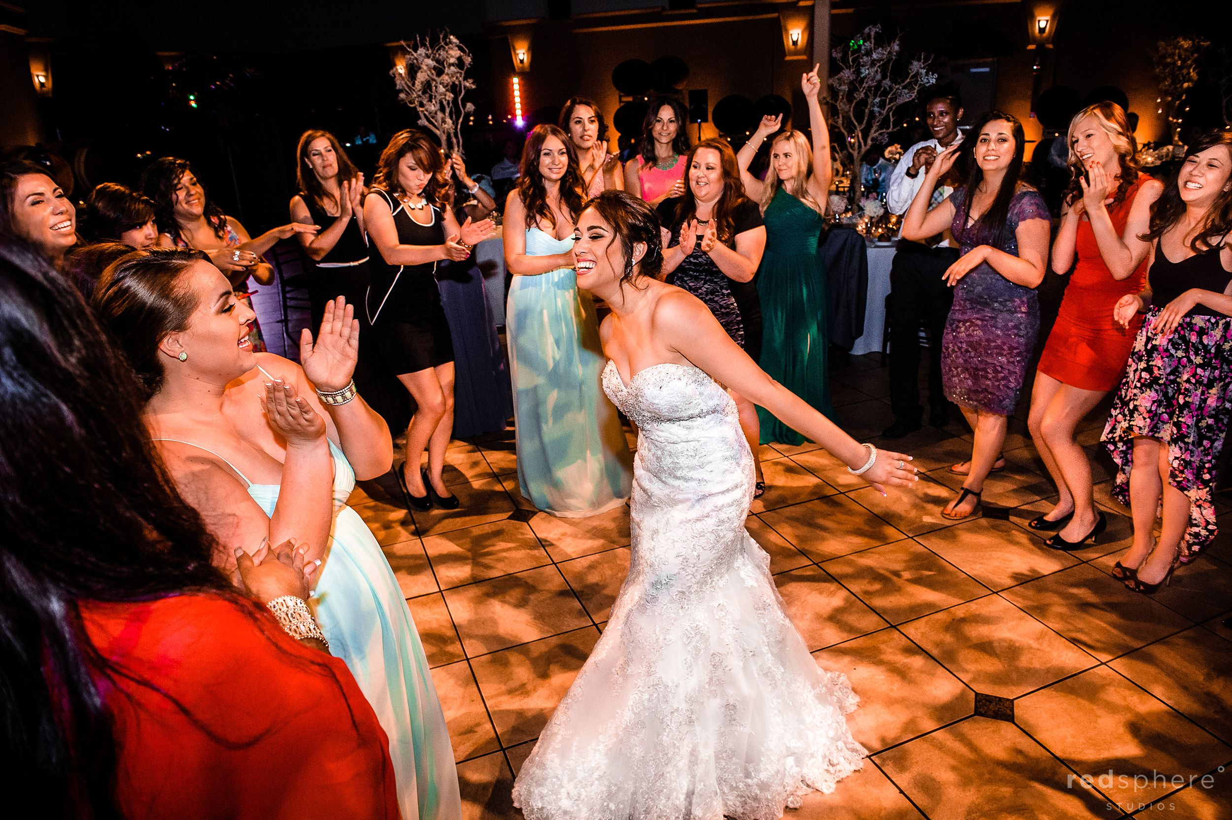 Bride Dancing While Guests Clap and Engage