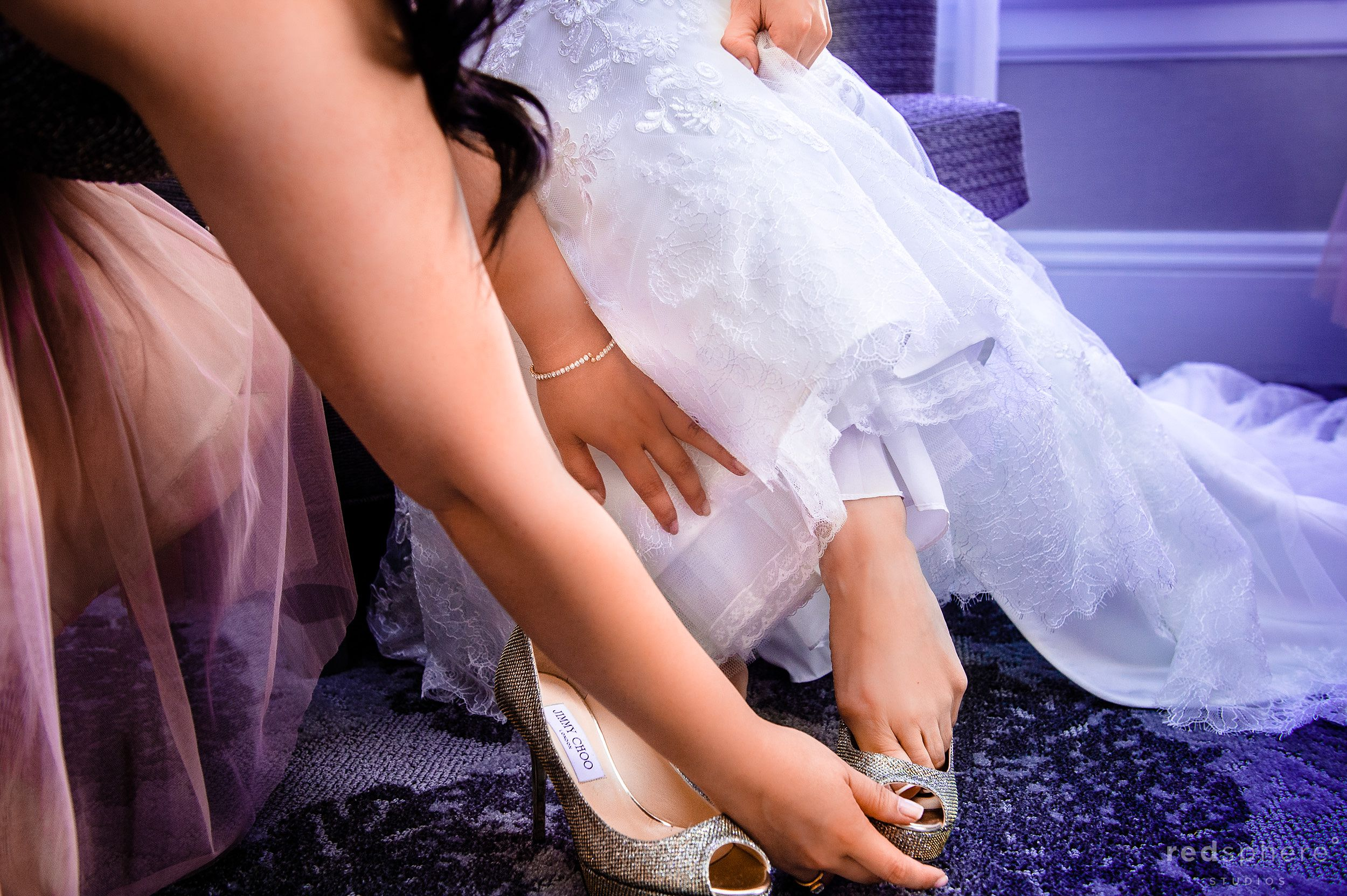Bride Putting on Heels