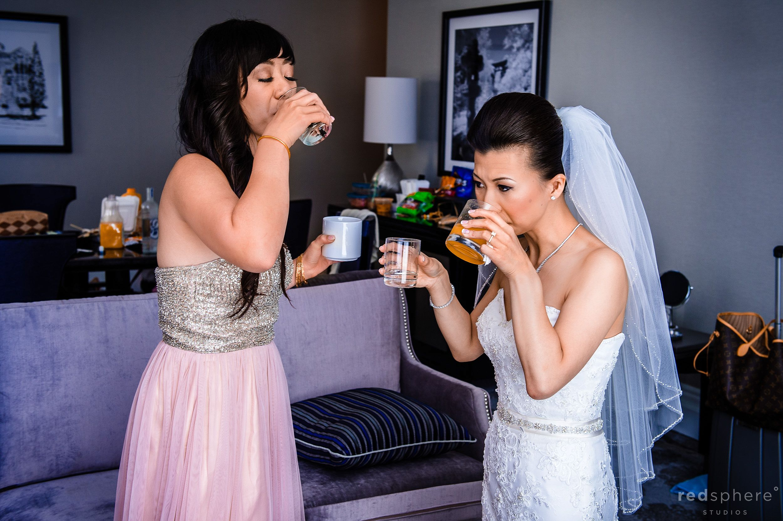 Bride and Bridesmaid Sharing Drinks Before Fairmont Hotel Wedding Ceremony