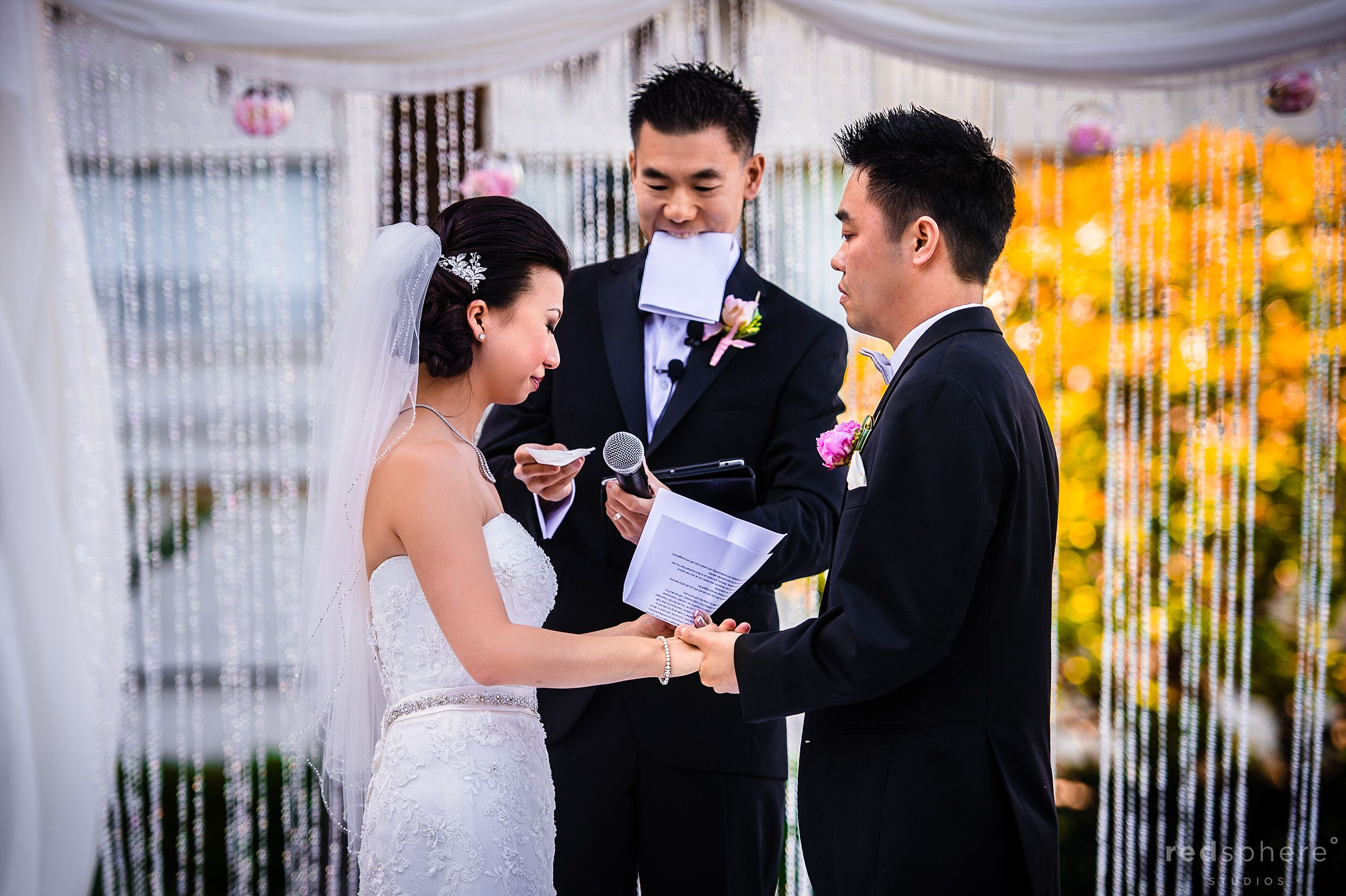 Bride and Groom Sharing Vows at Fairmont Hotel Wedding Grounds