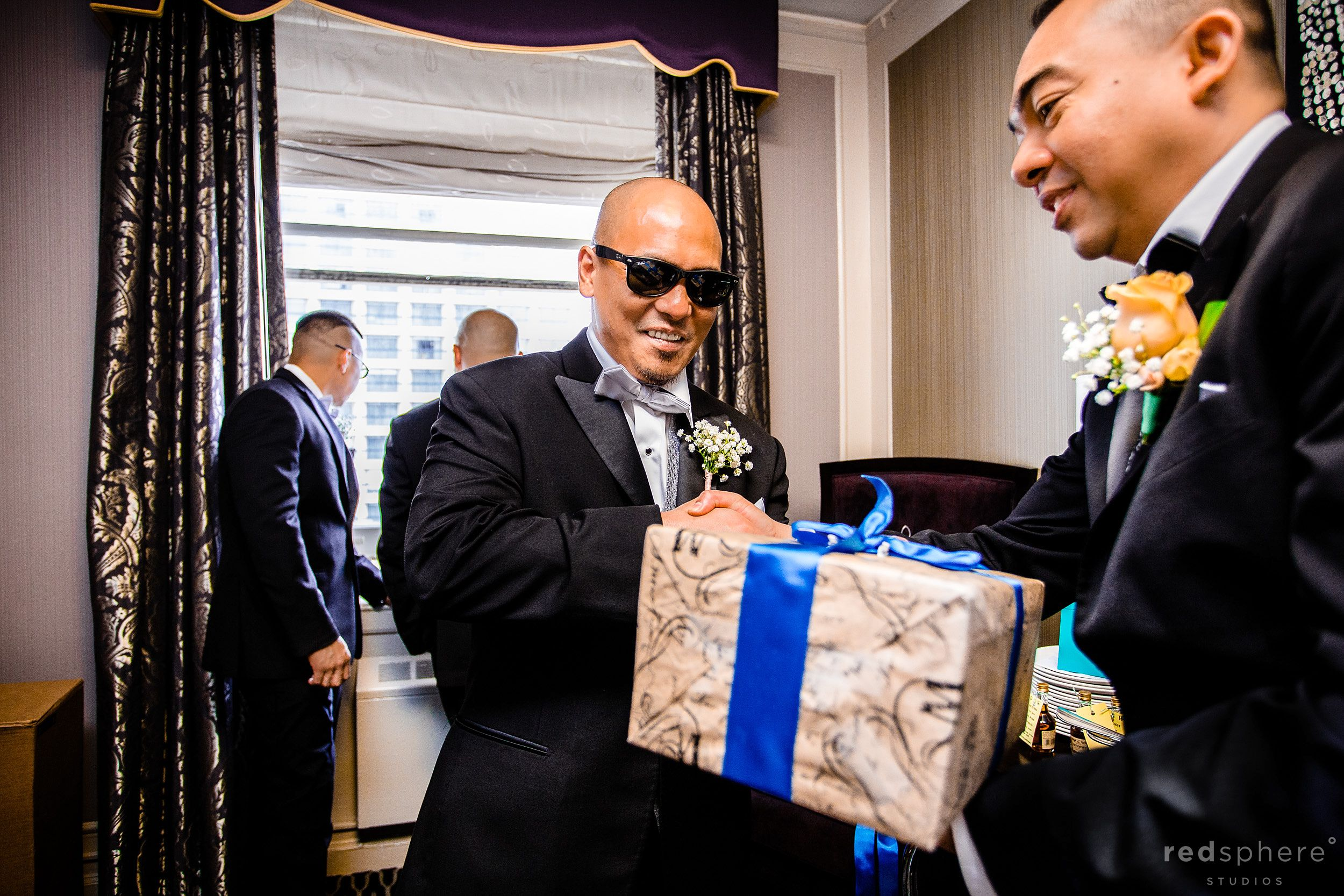 Groomsmen Giving Gifts to the Man