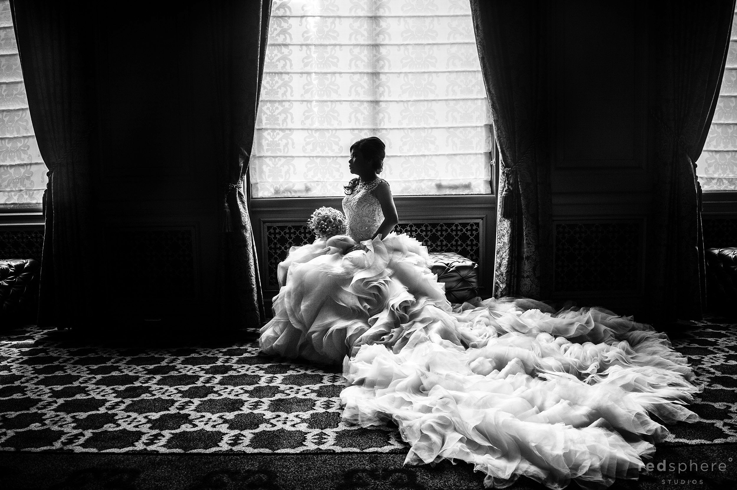 Bride Looks out the Window in Wedding Dress at Mission Dolores Basilica & Dominic's at Oyster Point, San Francisco, Black and White