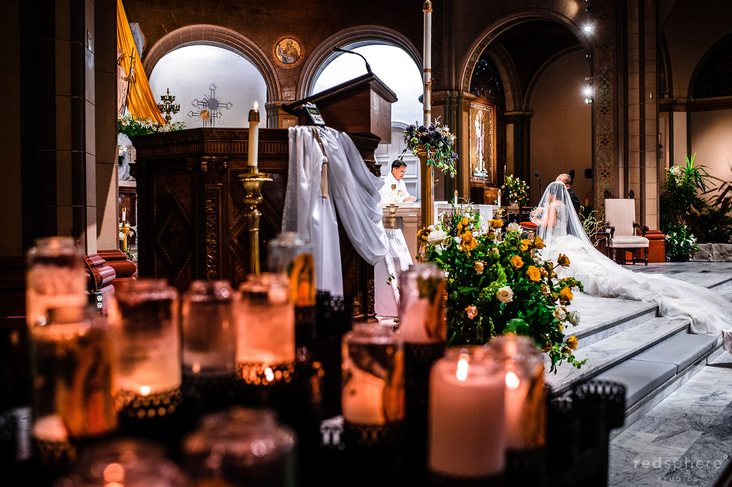 Bride and Groom at Mission Dolores Basilica Behind Candles