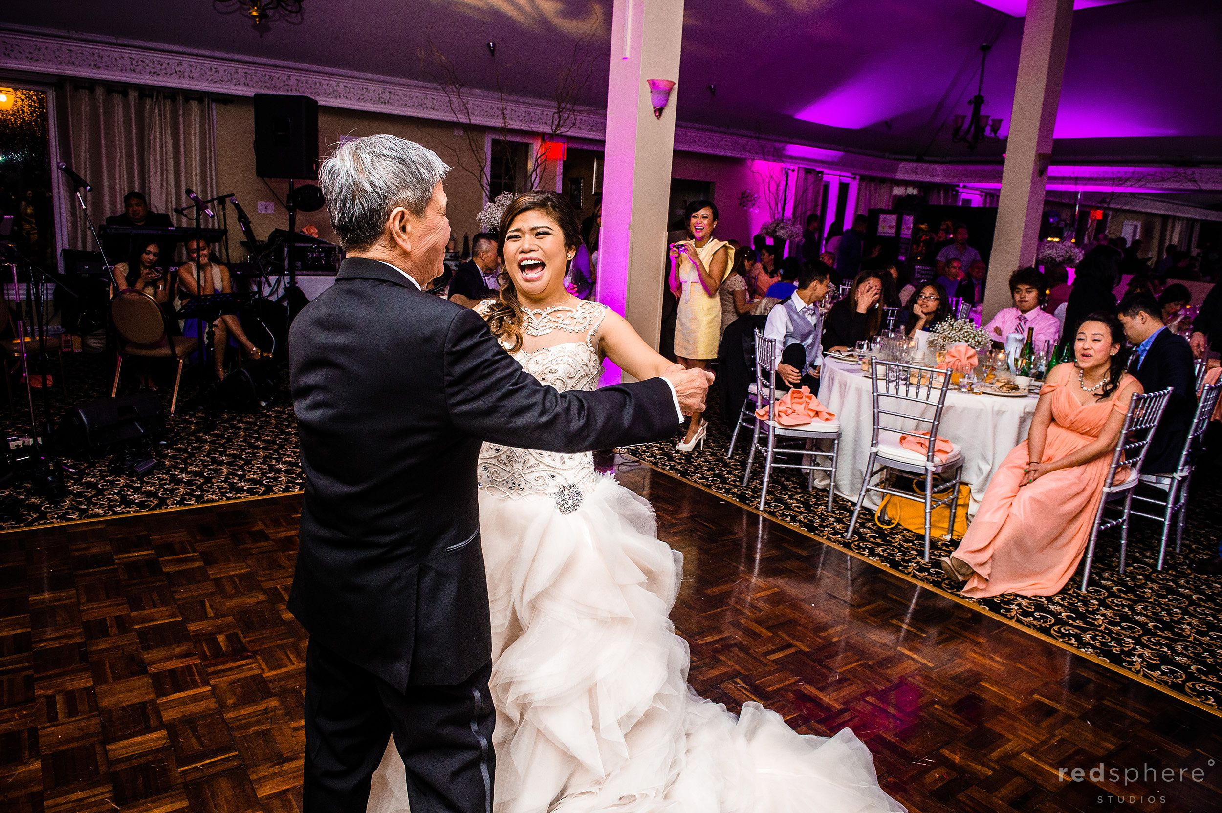 Bride Shares a Dance with Her Dad at Wedding Reception