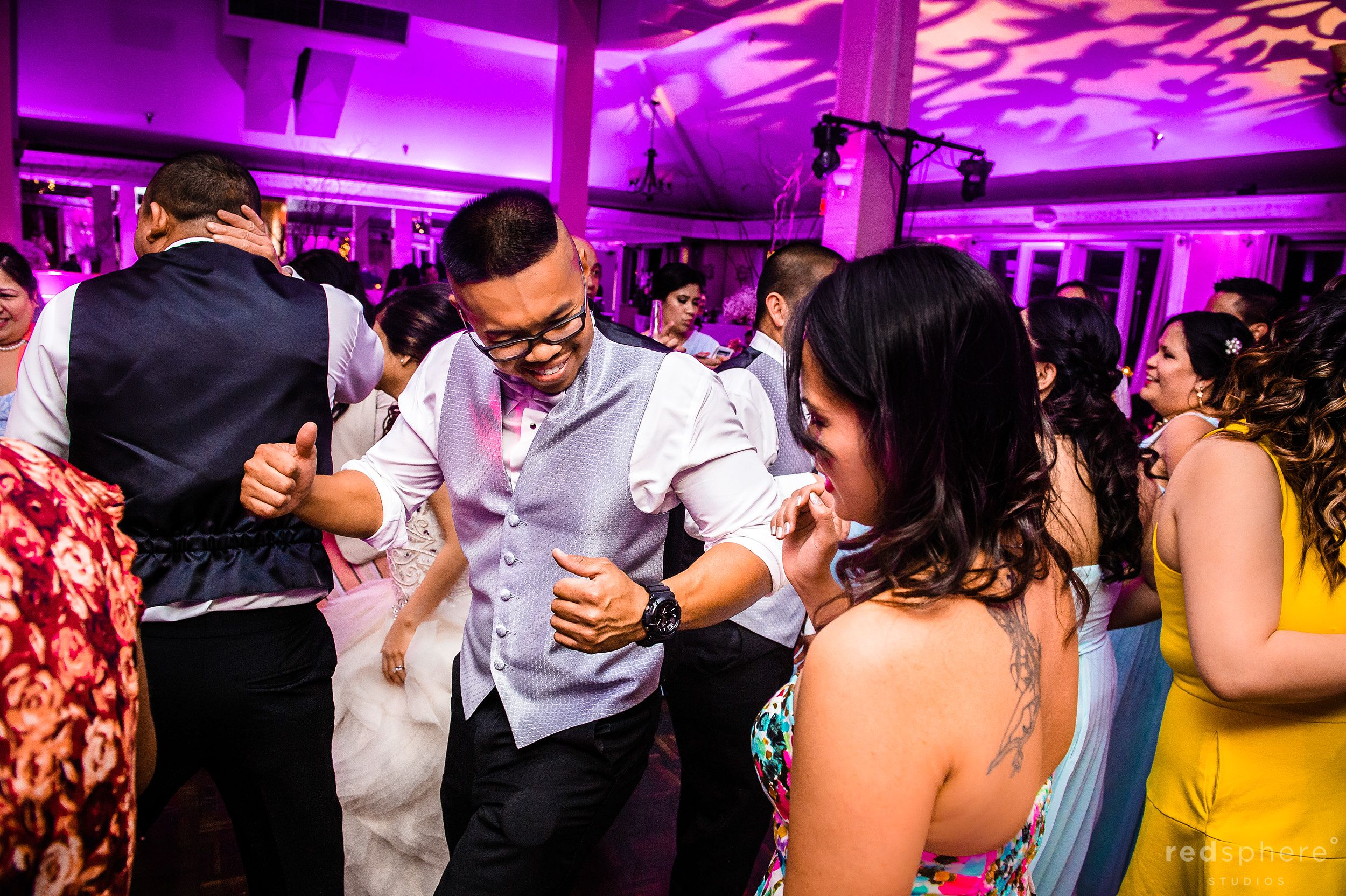 Guests Link Up To Dance To Wedding Reception Music