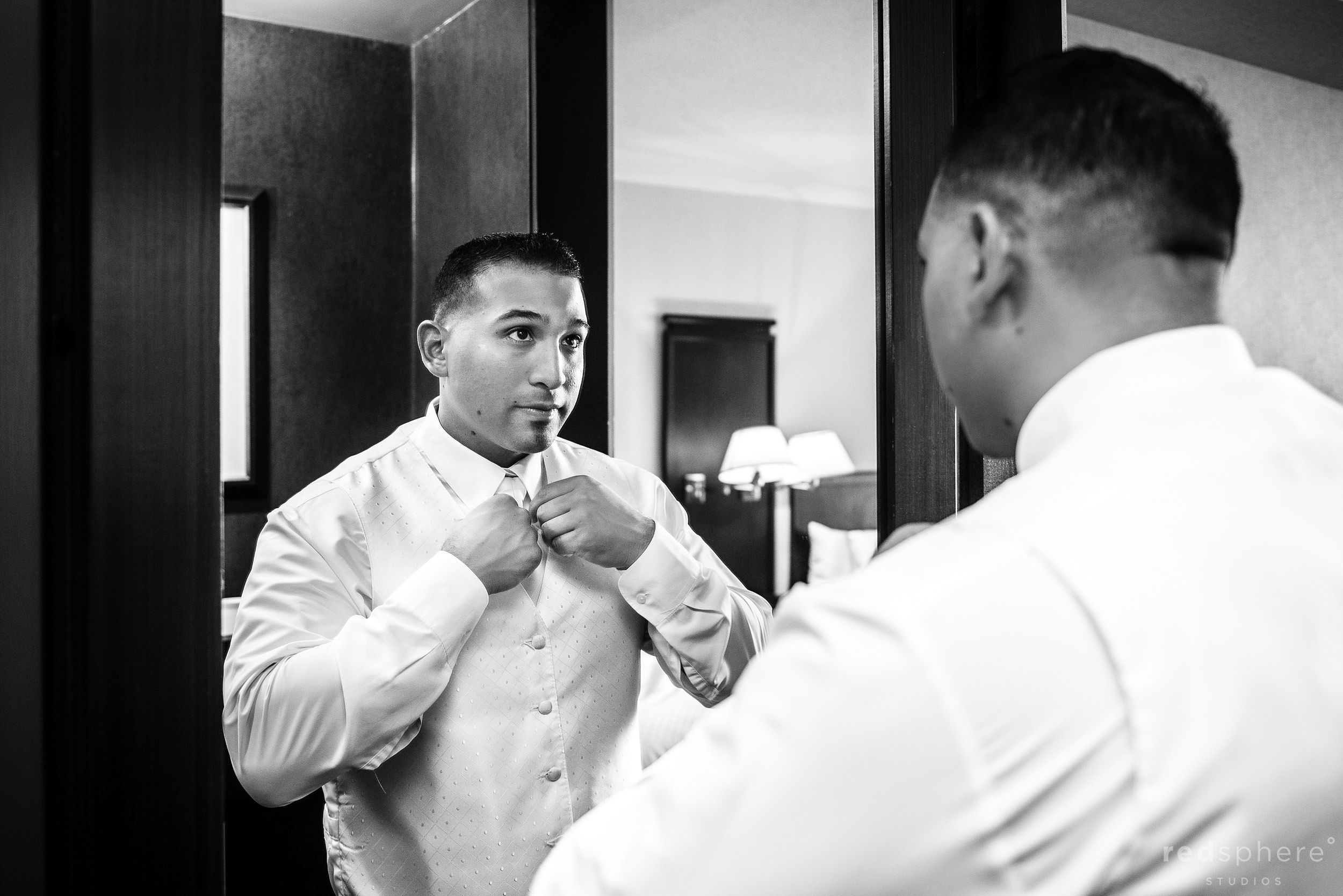 Groom Putting The Finishing Touches On Tie, Black and White