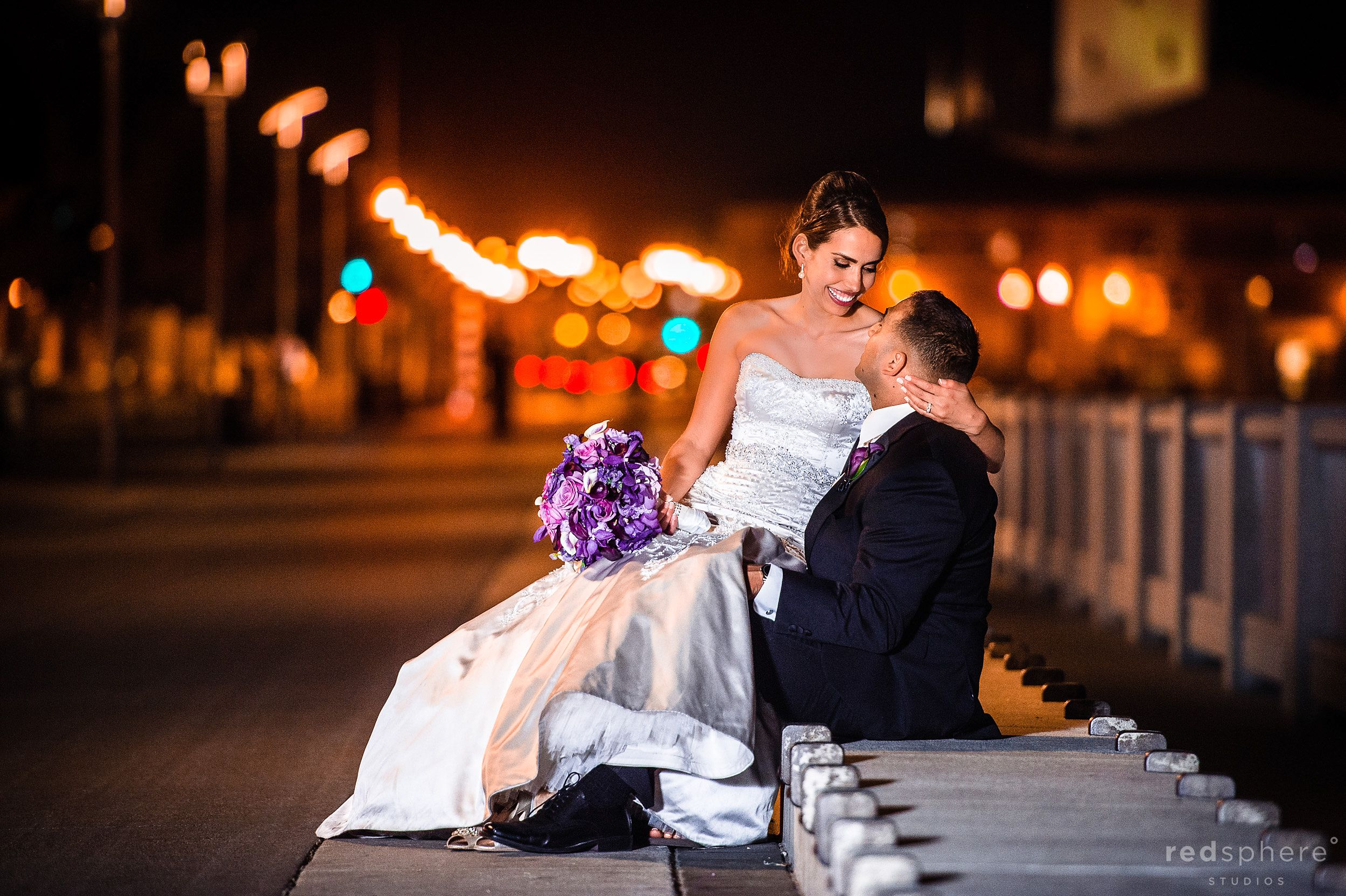 Bride Sits On Grooms Lap at Pier 7, San Francisco Nightlife Bokeh