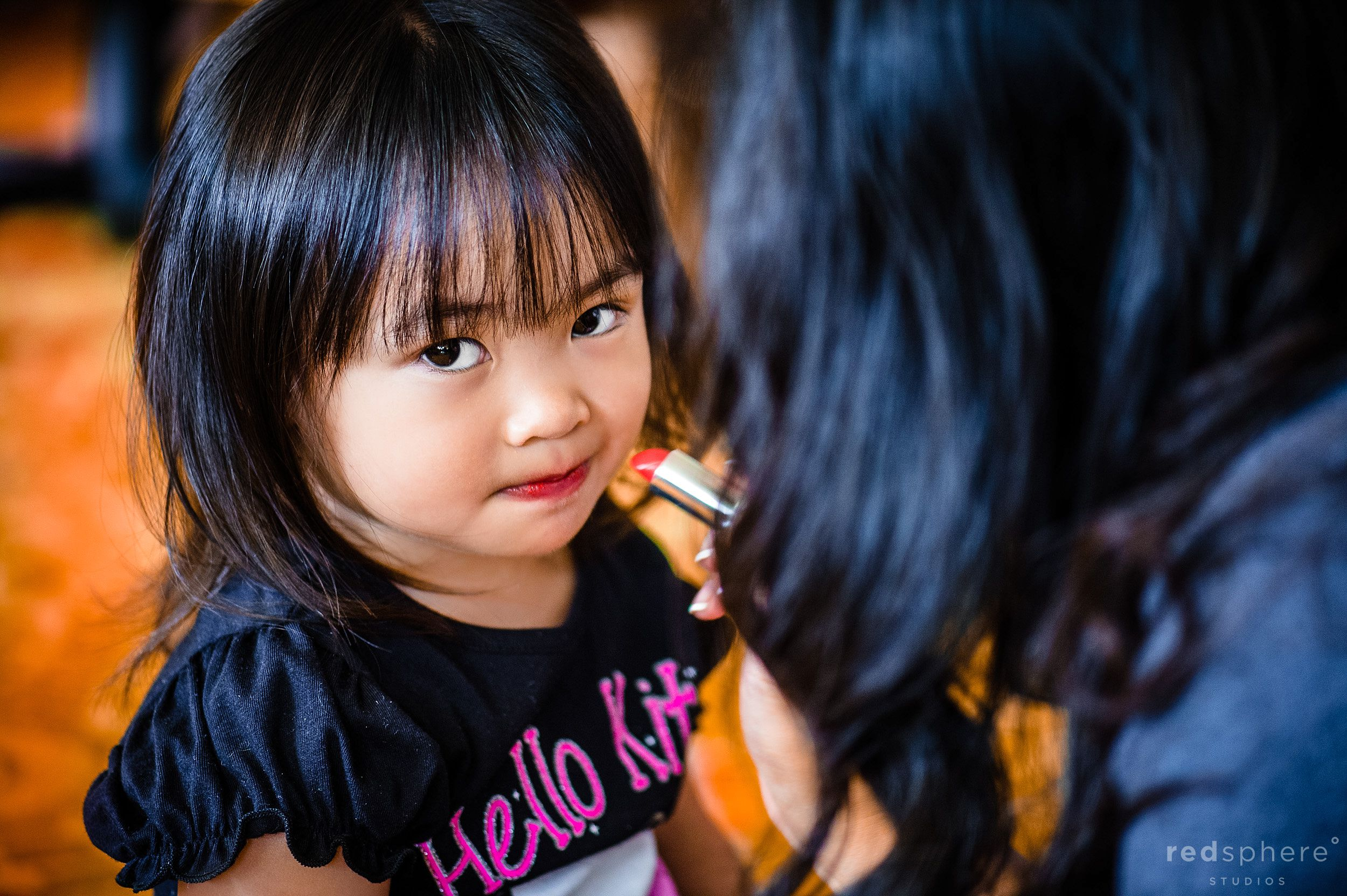 Little Girl Gets red Lipstick Applied Prior to Wedding Ceremony, Danville California