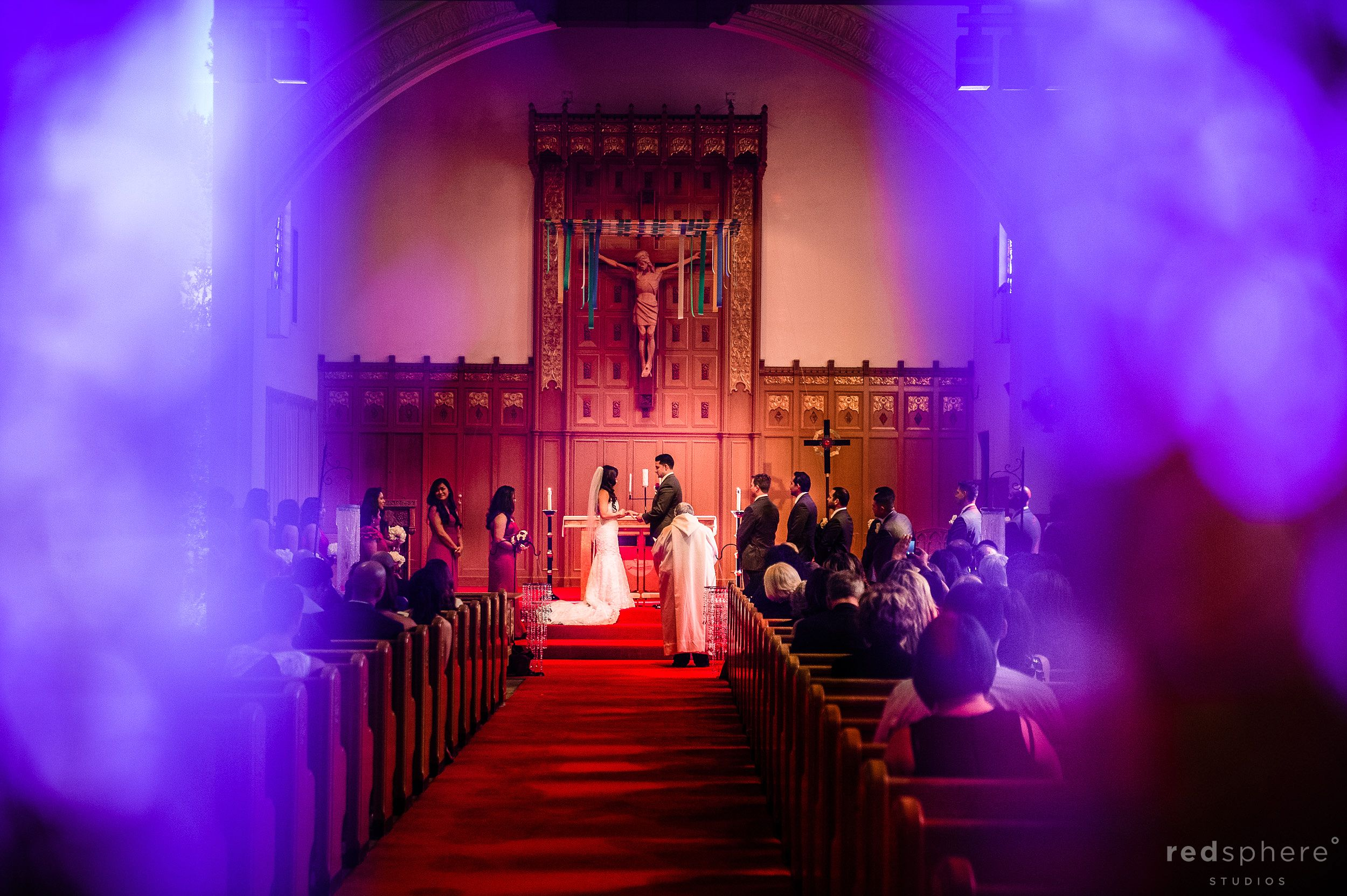 Bride and Groom Share A Special Moment, Holding Hands While Vows Are Being Said, Santa Maria Church, Orinda, CA