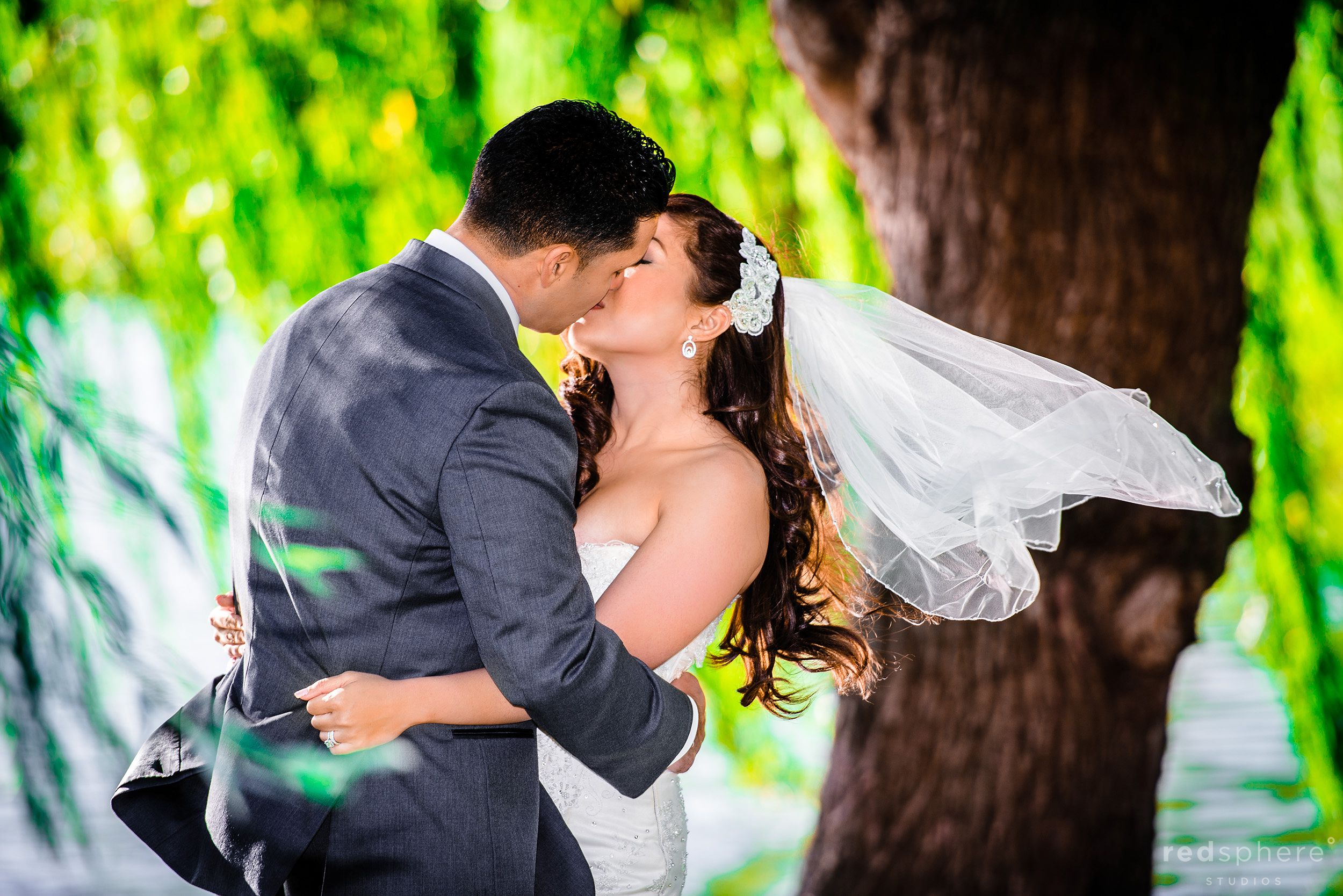 Bride and Groom Kiss As The Wind Pushes The Veil,  Crow Canyon Country Club