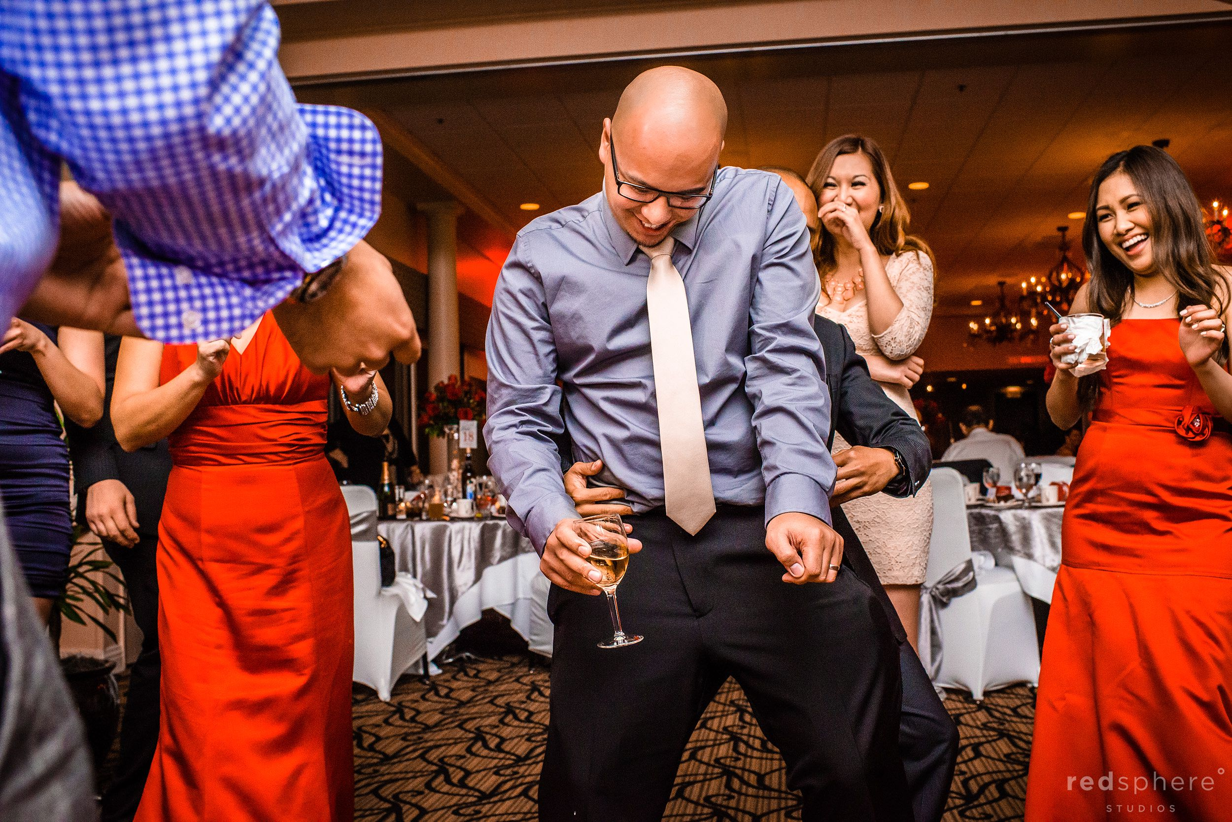 Wedding Guests Dancing With Champagne In Hands