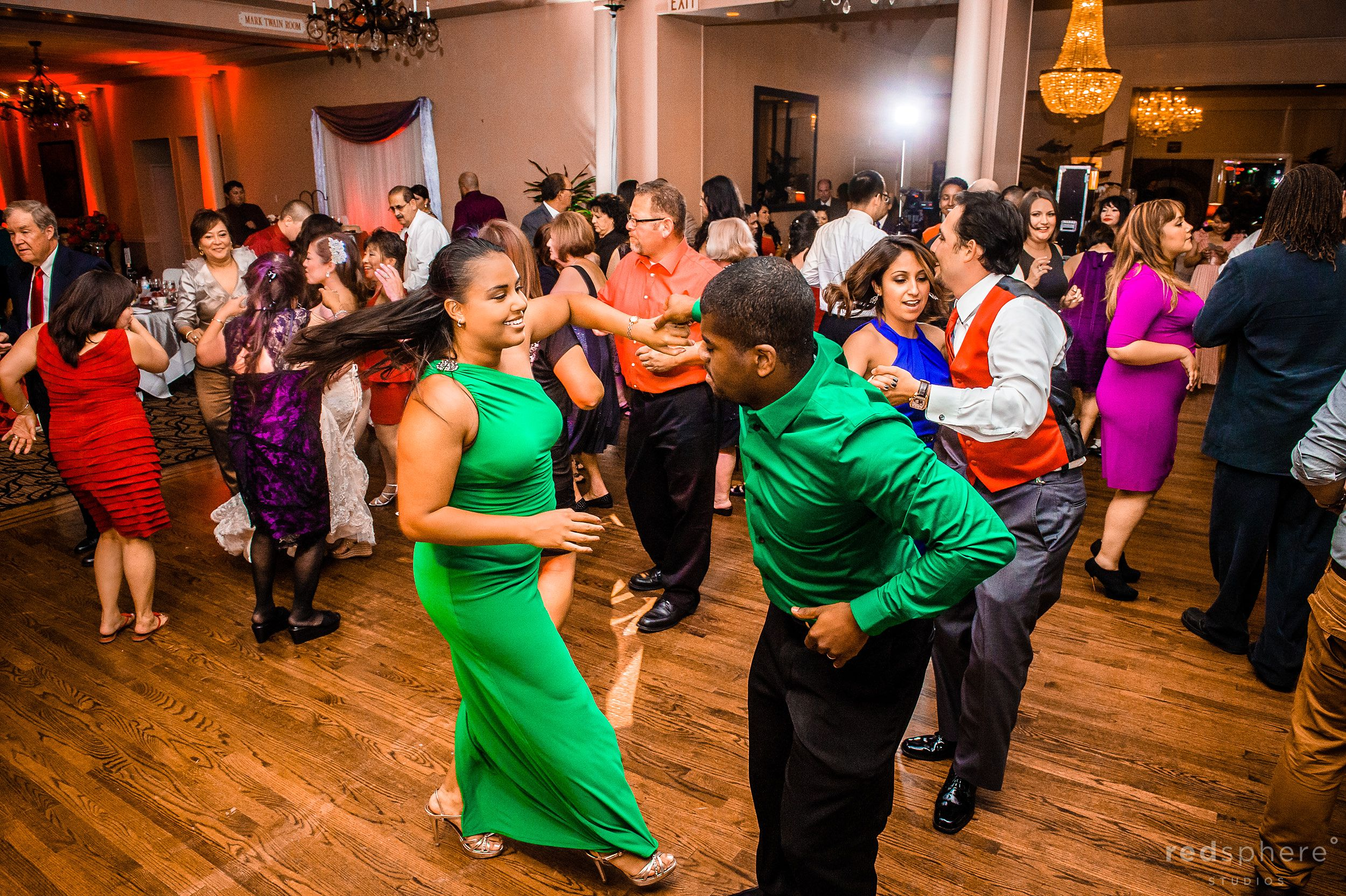 Guests in Green Dancing On The Dance Floor at Crow Canyon Country Club, Danville, CA Wedding Reception