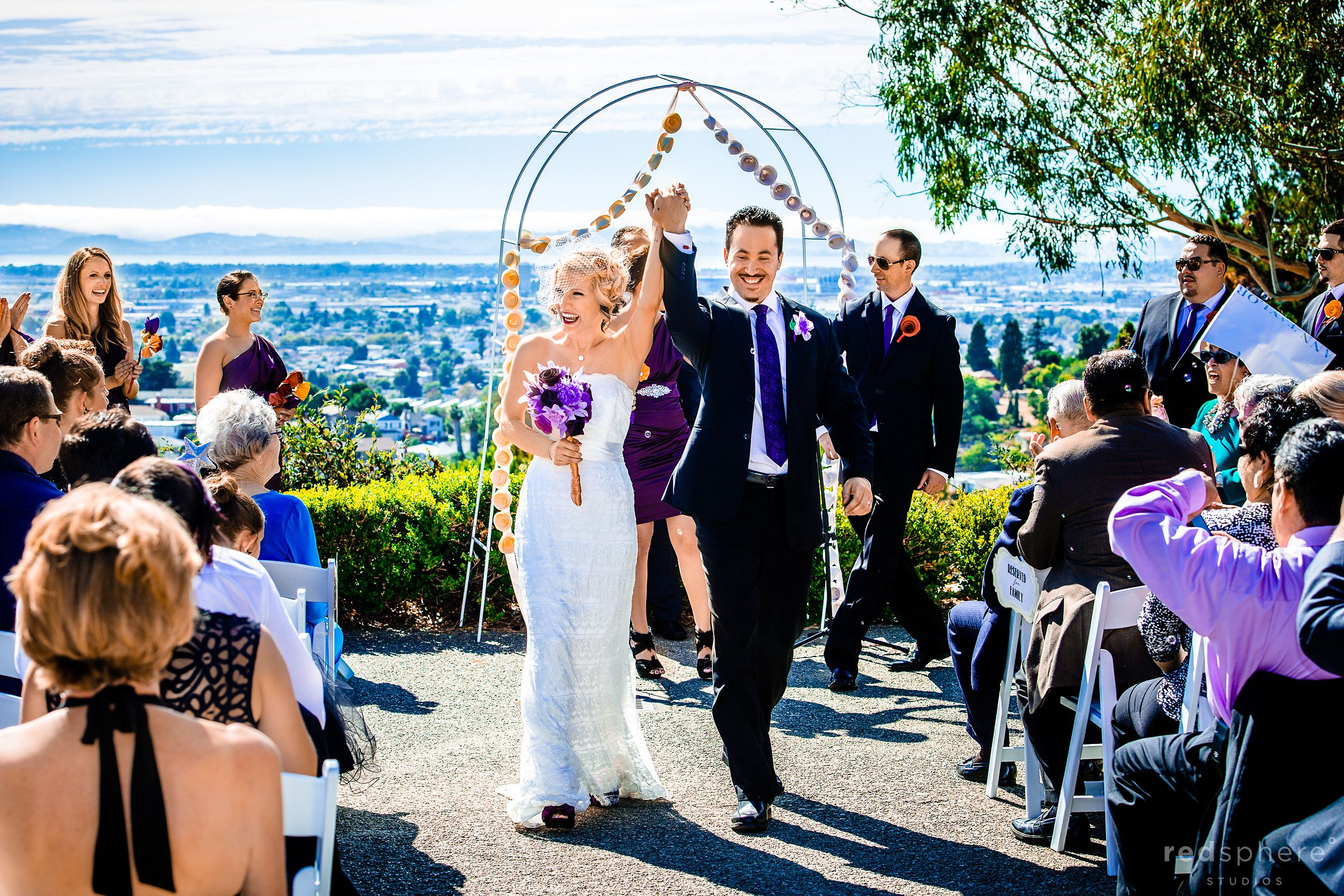 Bride and Groom Walk Out With Hands Locked In The Air