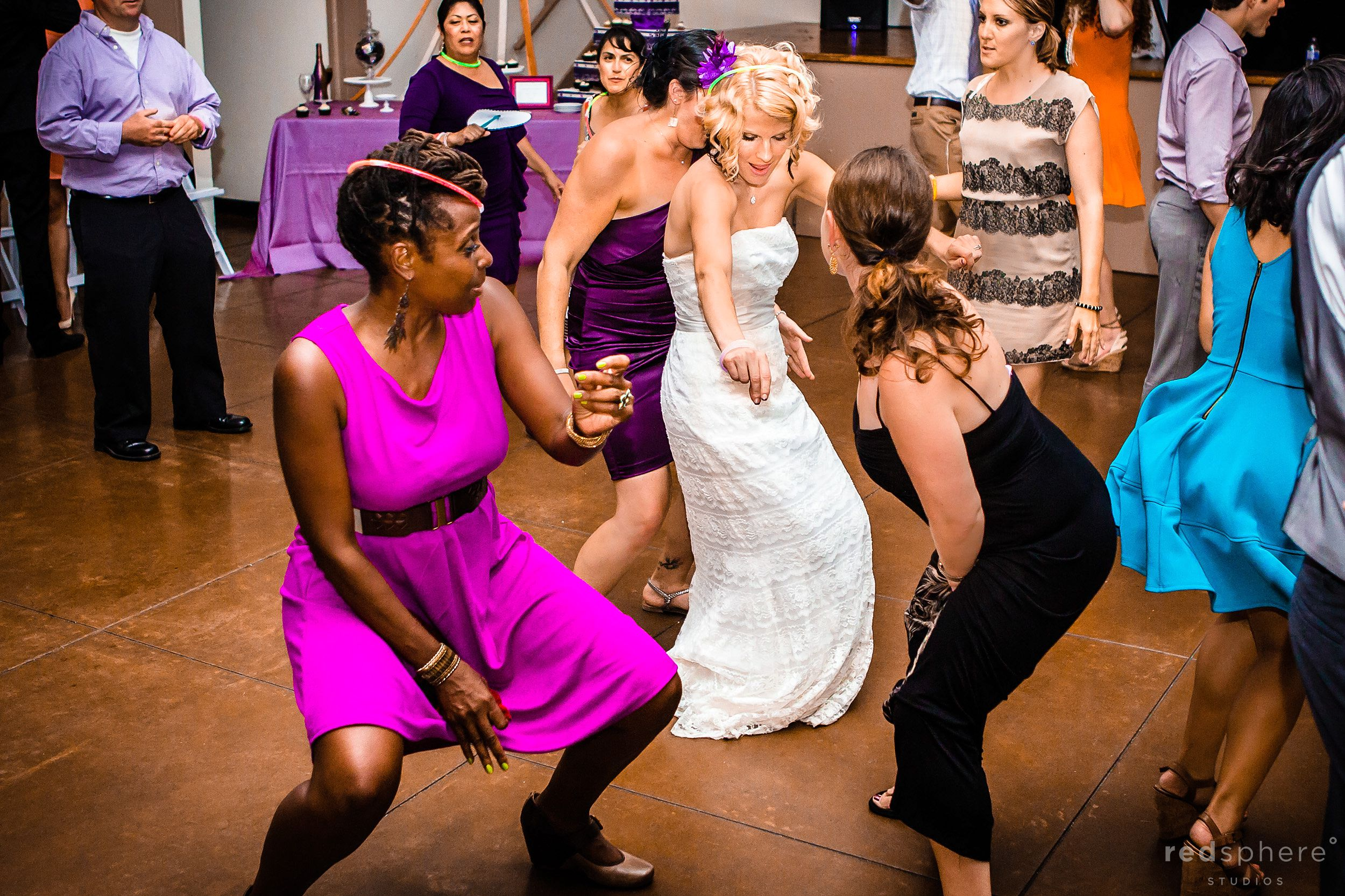 Bride Dances With Friends During Reception, Snow Building Oakland