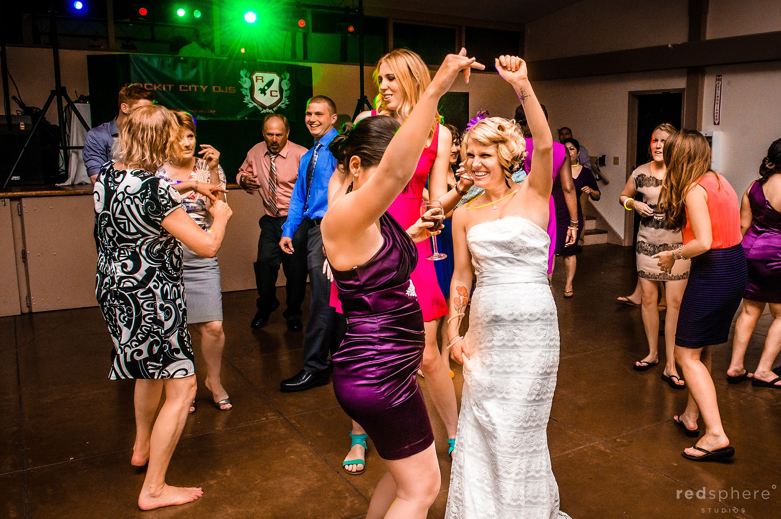 Bride Dancing With Bridesmaid at Oakland Zoo's Snow Building