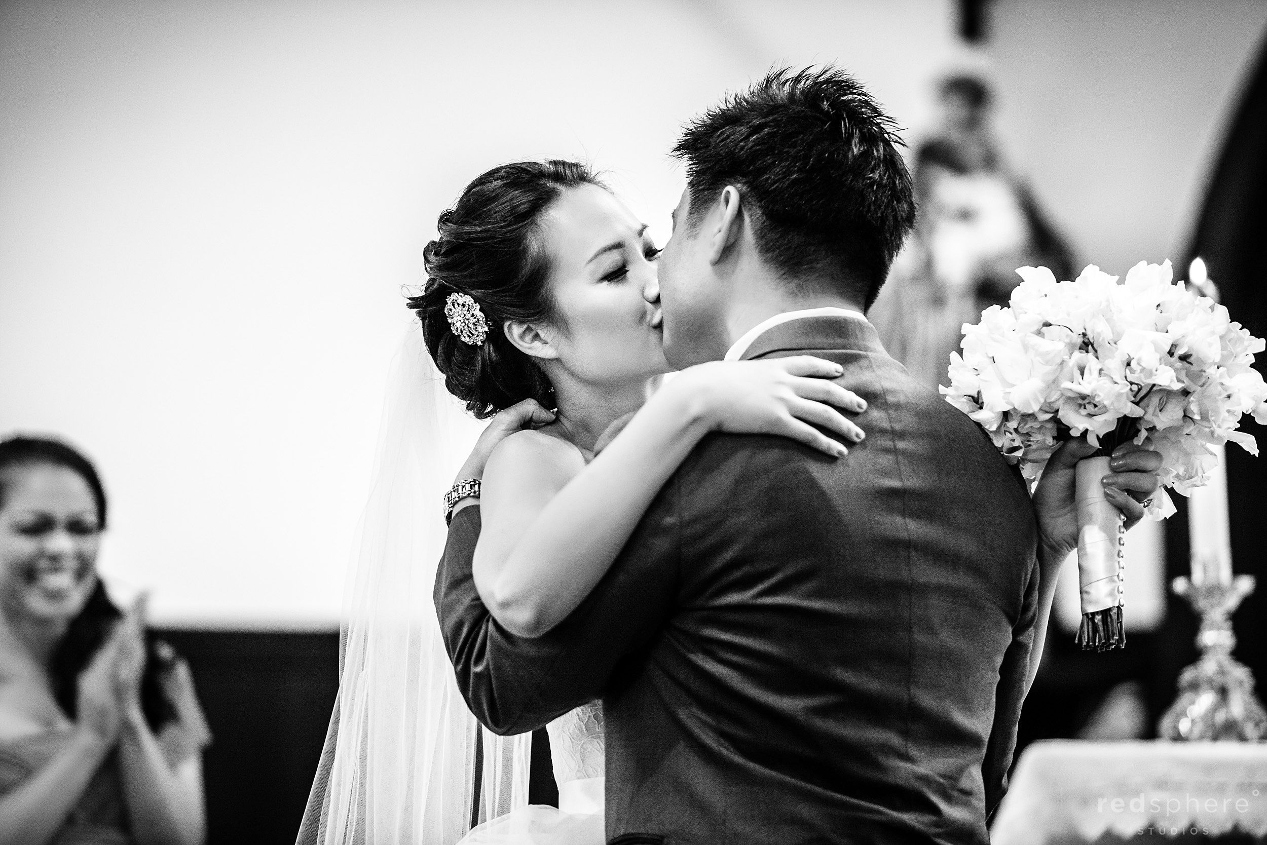 Bride and Groom Kiss, Black and White at Church of the Nativity, Menlow Park, CA