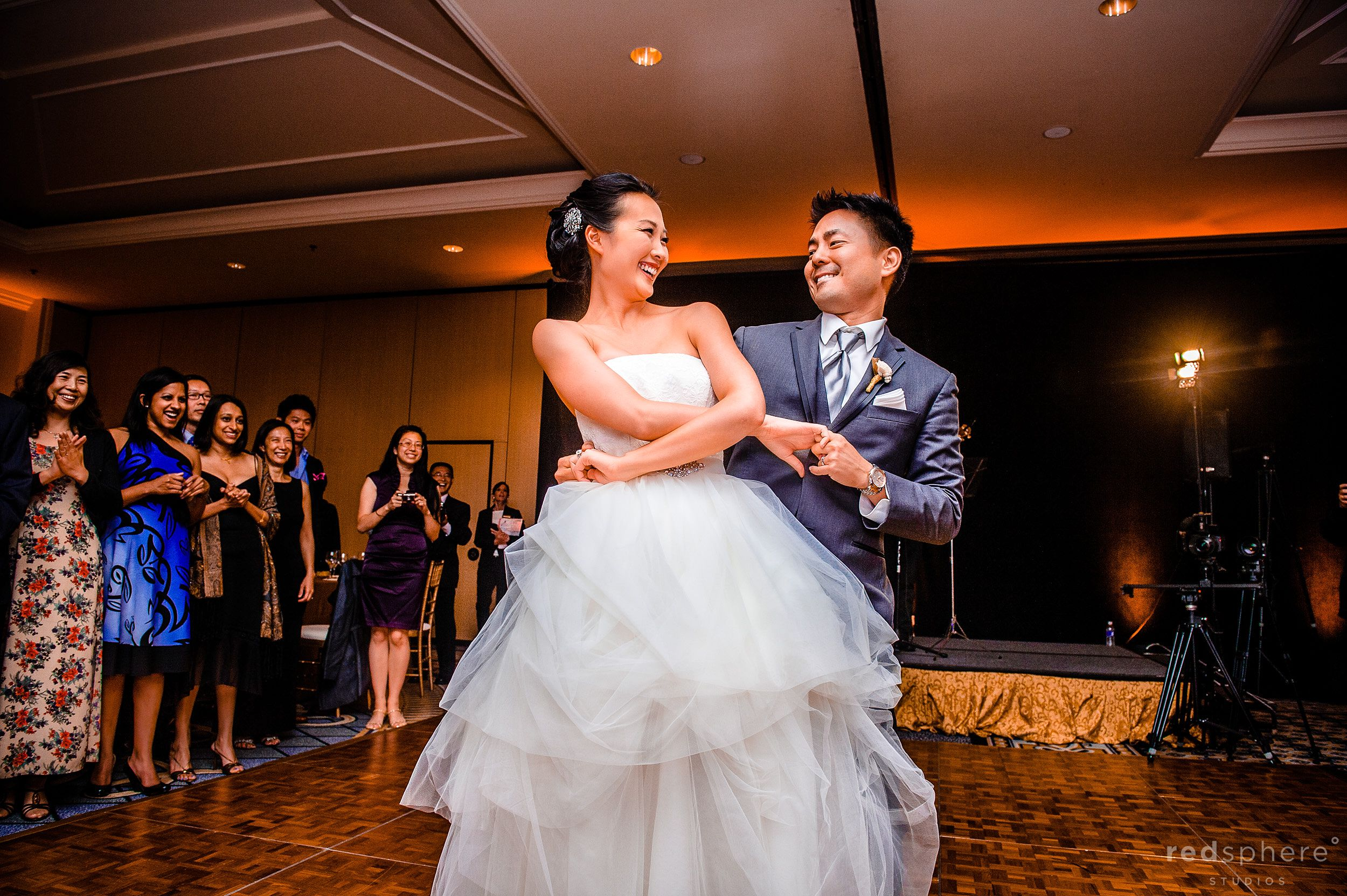 Bride and Groom Doing A Special Dance While on The The Ritz Carlton Ballroom