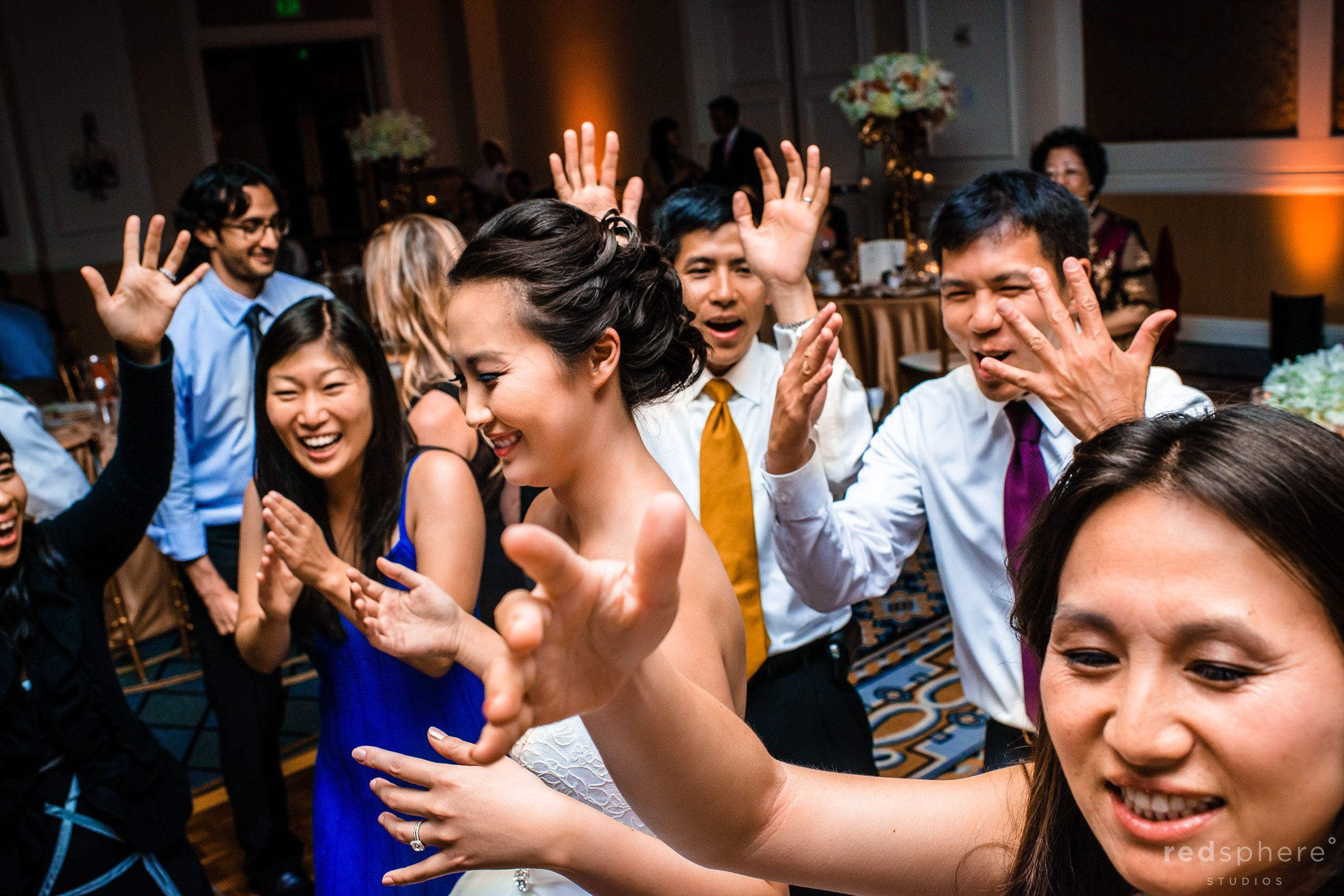 Guests Dance Simultaneously in The Ritz Carlton Ballroom