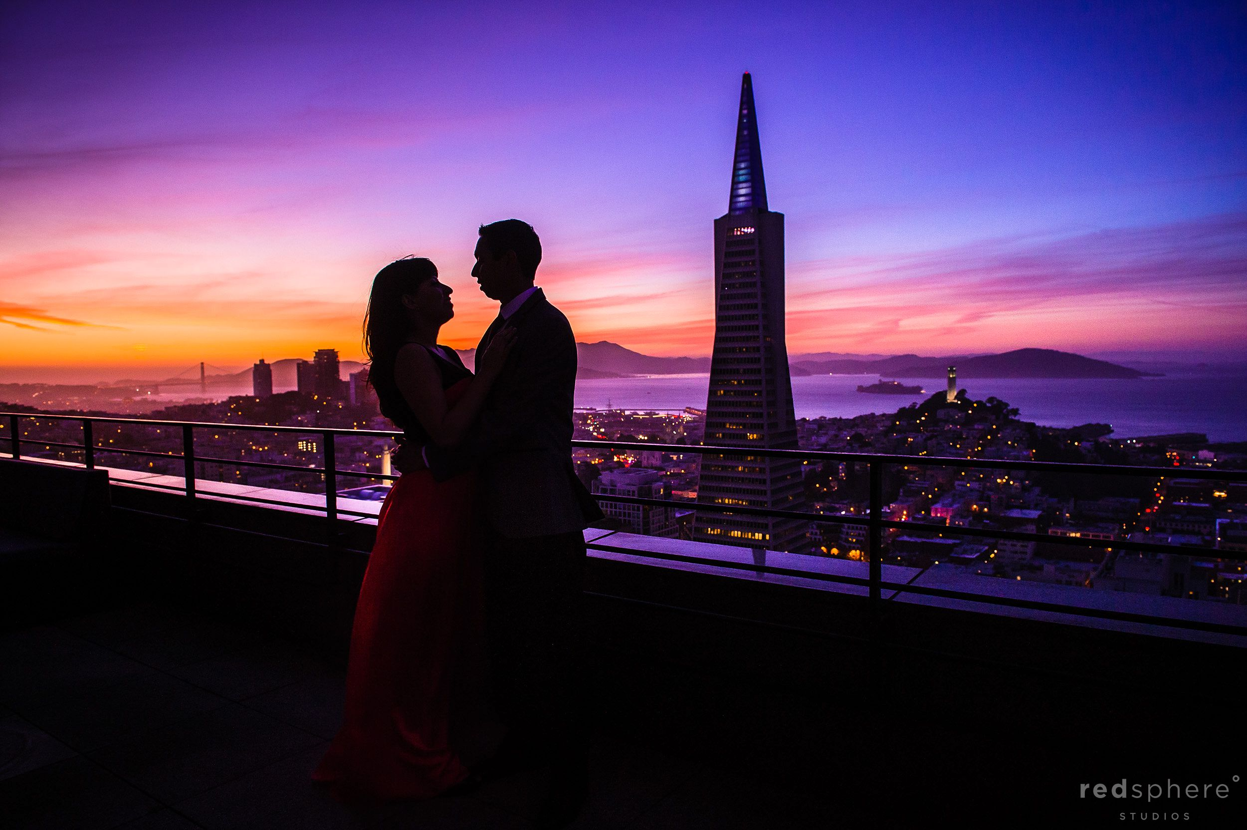 Couple and Transamerica Pyramid Silhouette on San Francisco Mandarin Oriental Hotel Balcony