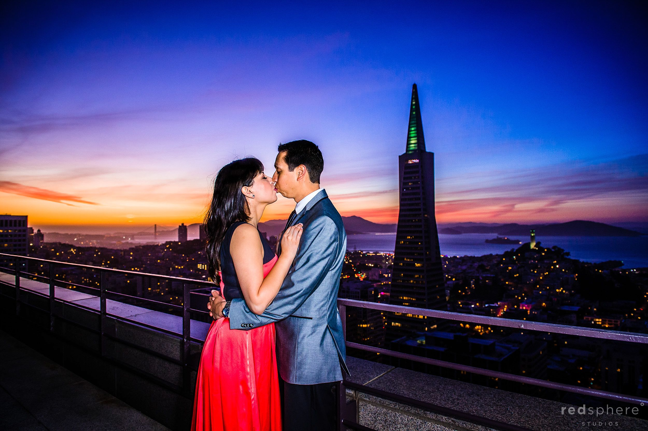 Couple Kiss Against San Francisco Skyline View From Mandarin Oriental Hotel Engagement