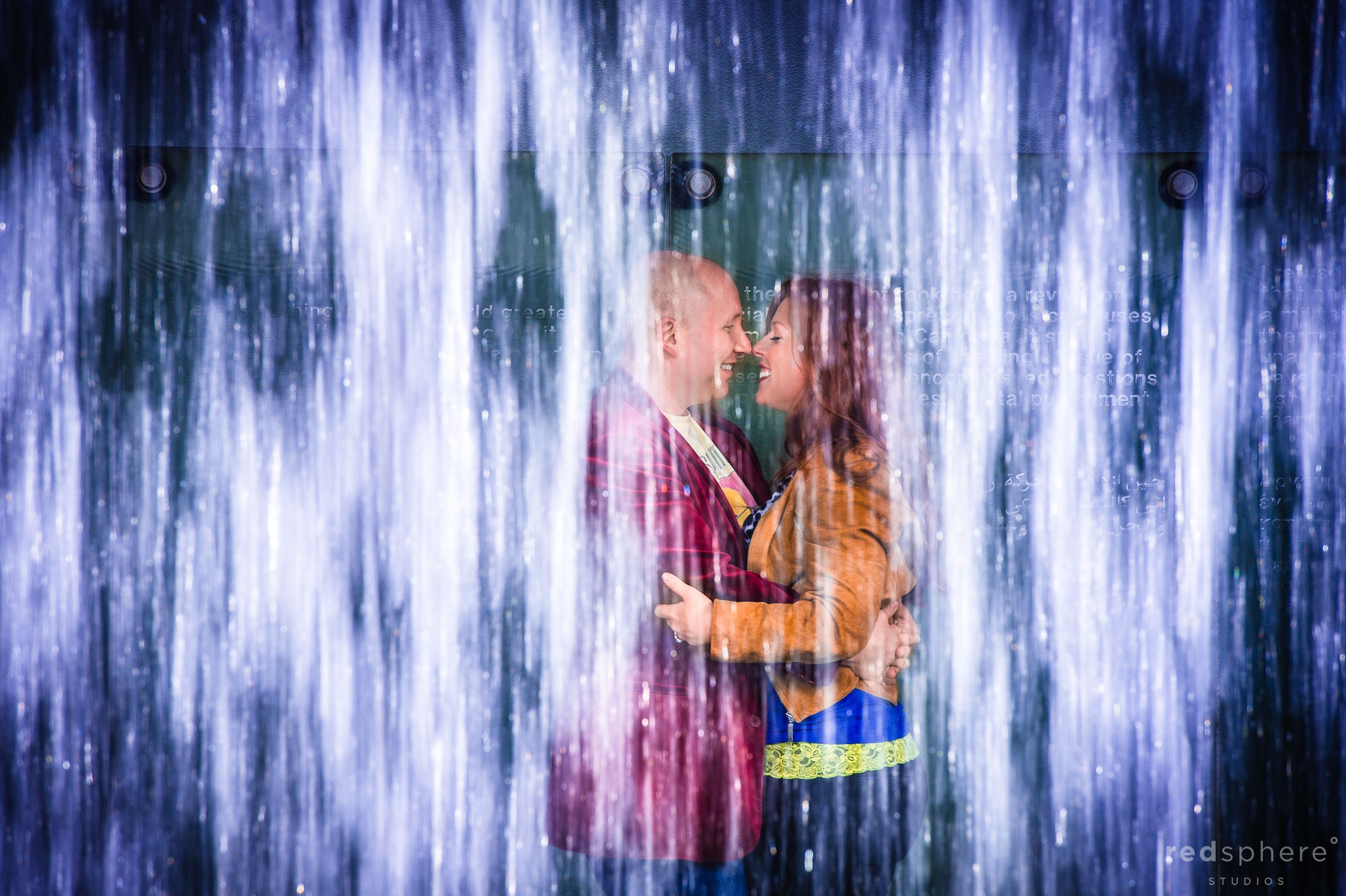 Intimate Couple Moment Behind Downtown San Francisco Waterfall