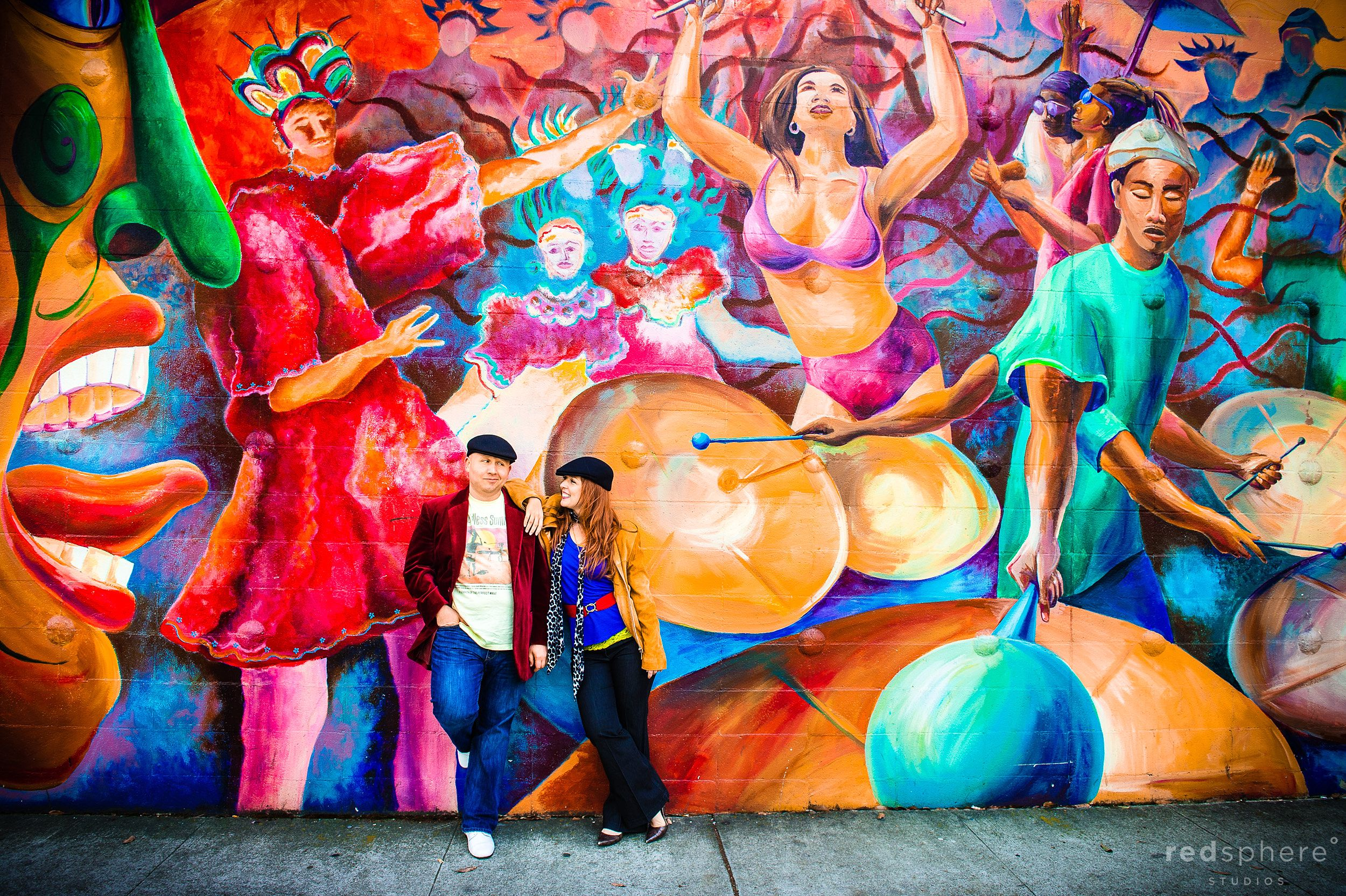 Couple Pose Against Murals of San Francisco's Mission District, Engagement