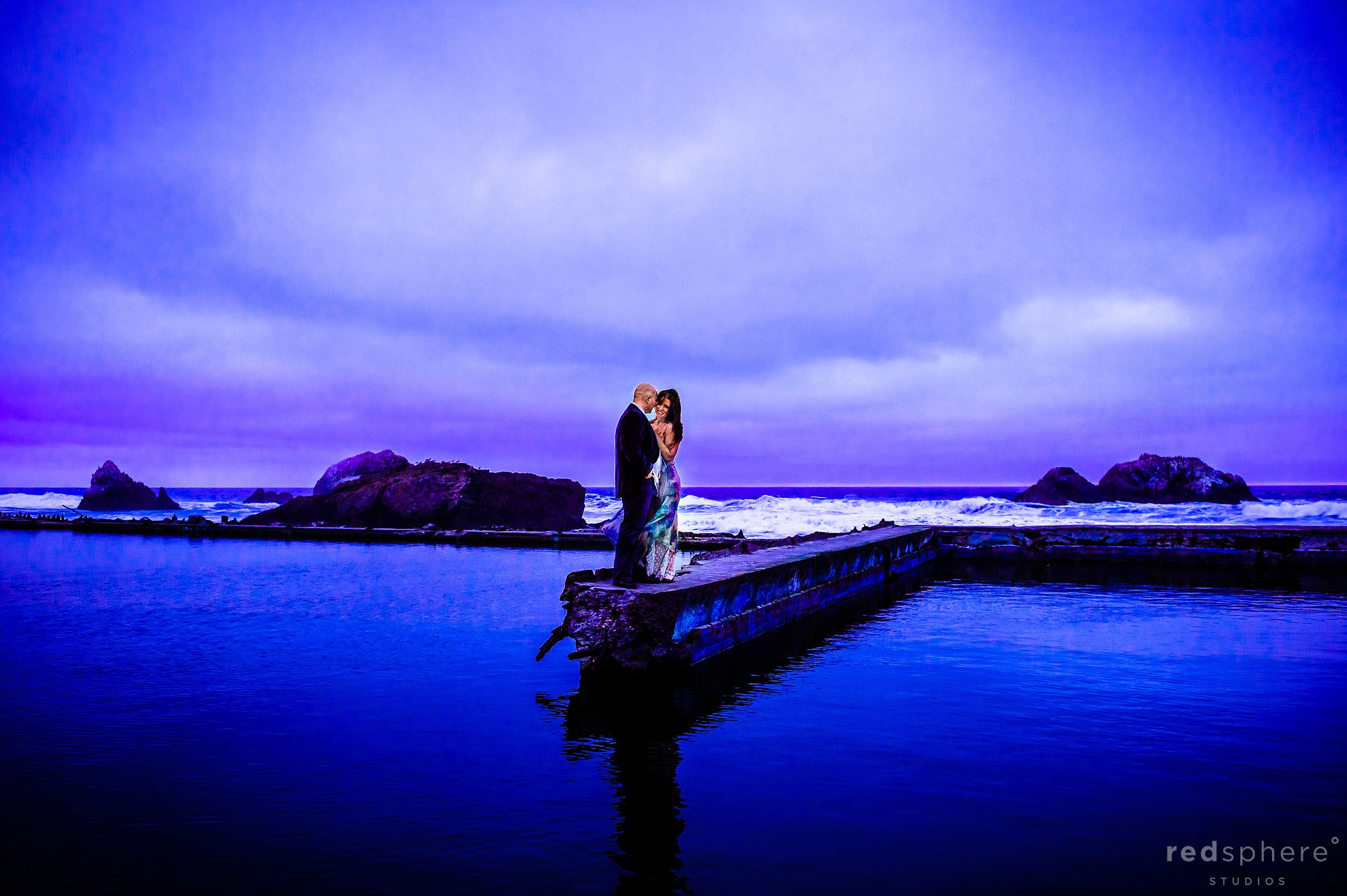 Couple Hugging in Suit and Dress, Engagement Pictures at Sutro Baths SF