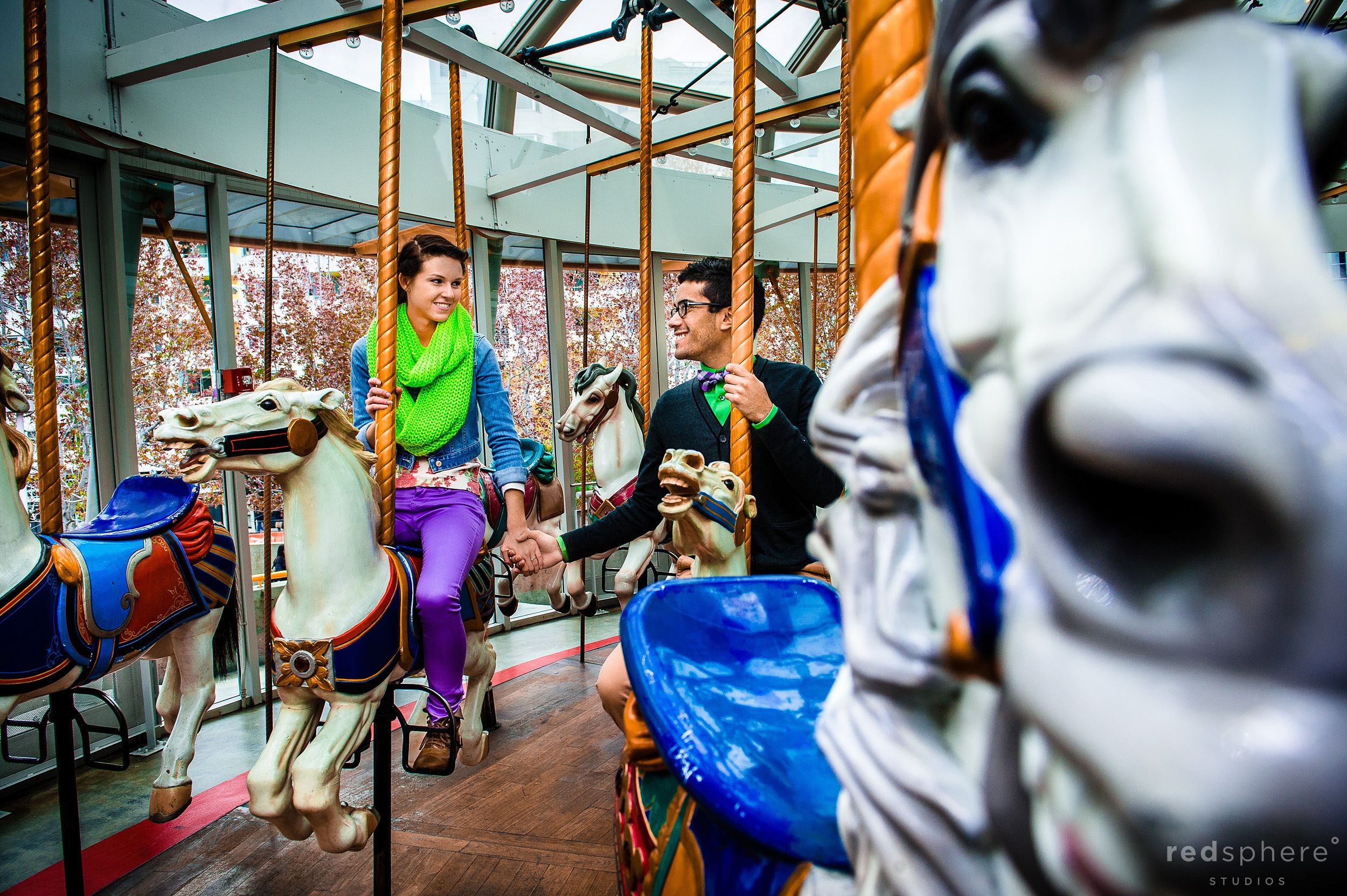 Couple Hold Hangs on Carousel, Unique Engagement Pictures