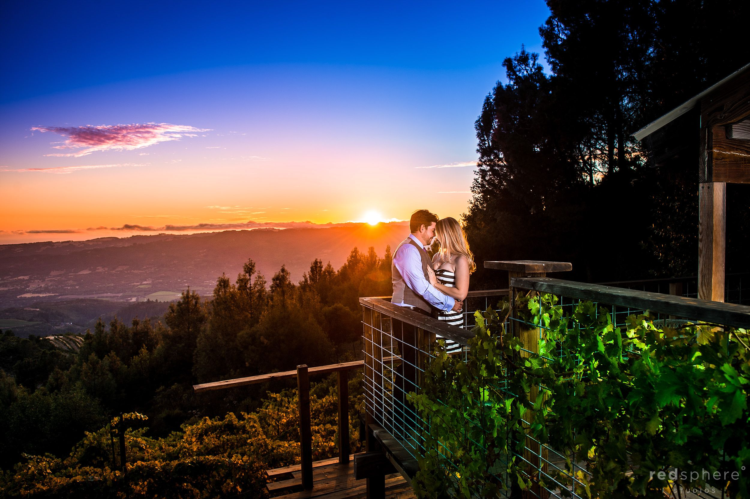 Couple Kiss Against Sonoma County Sunset