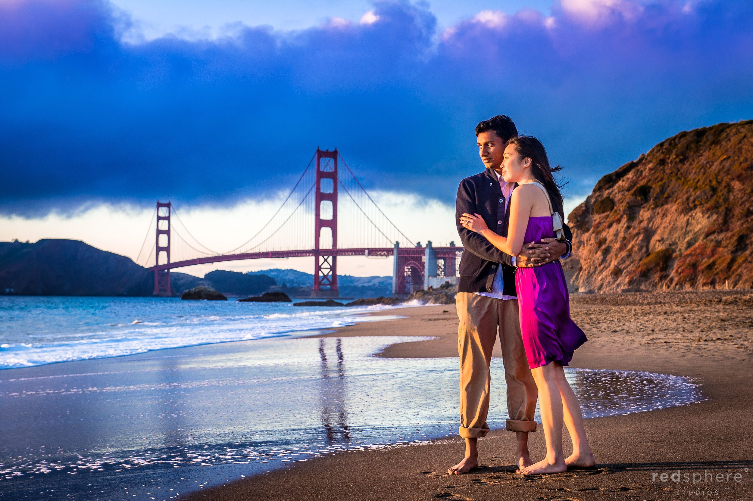 Couple Watch Sunset at Baker Beach, Golden Hour Engagement Sessions