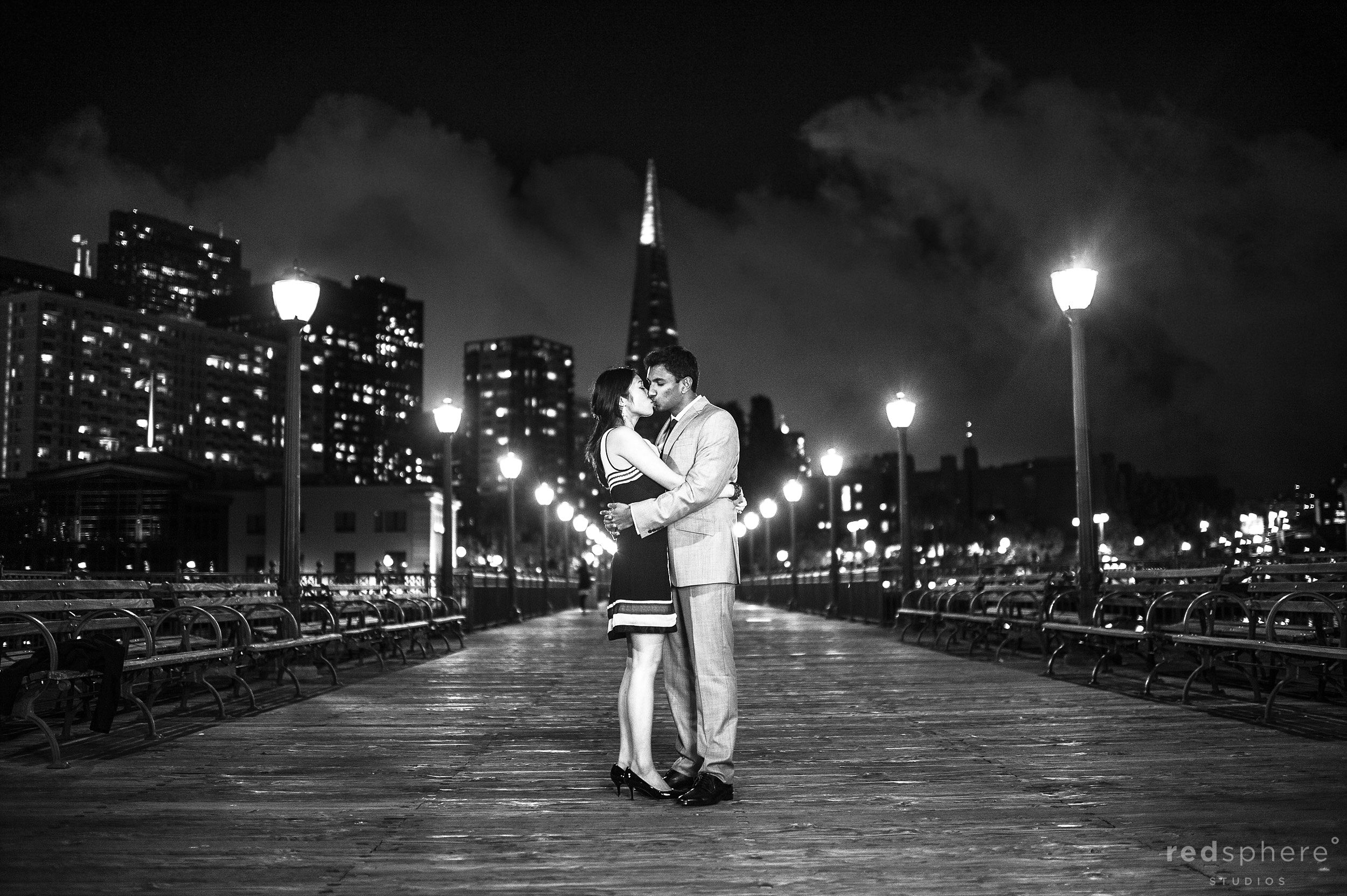 Couple Kiss in the Middle of Pier 7, Black and White SF Night Engagement
