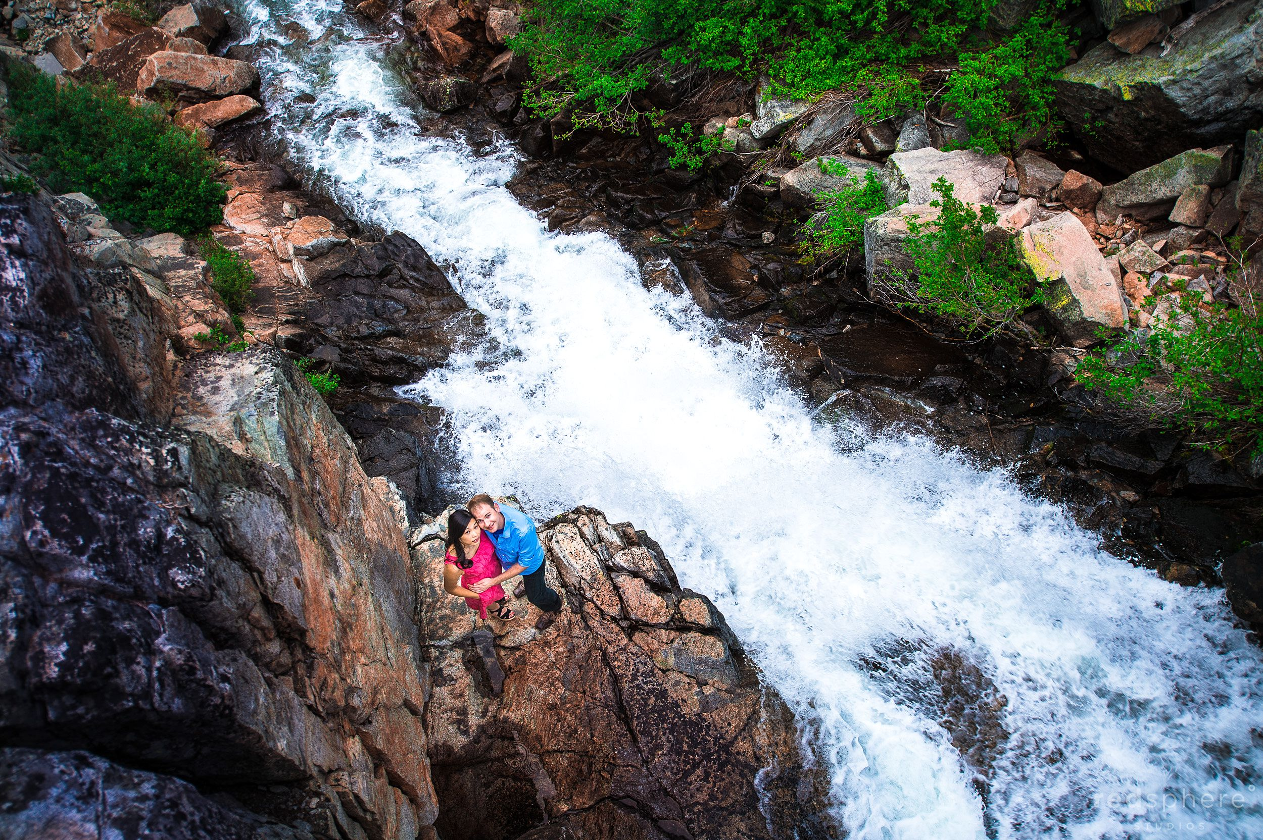 Couple Get Cozy on Rocks Along Roaring Lake Tahoe Waterfalls