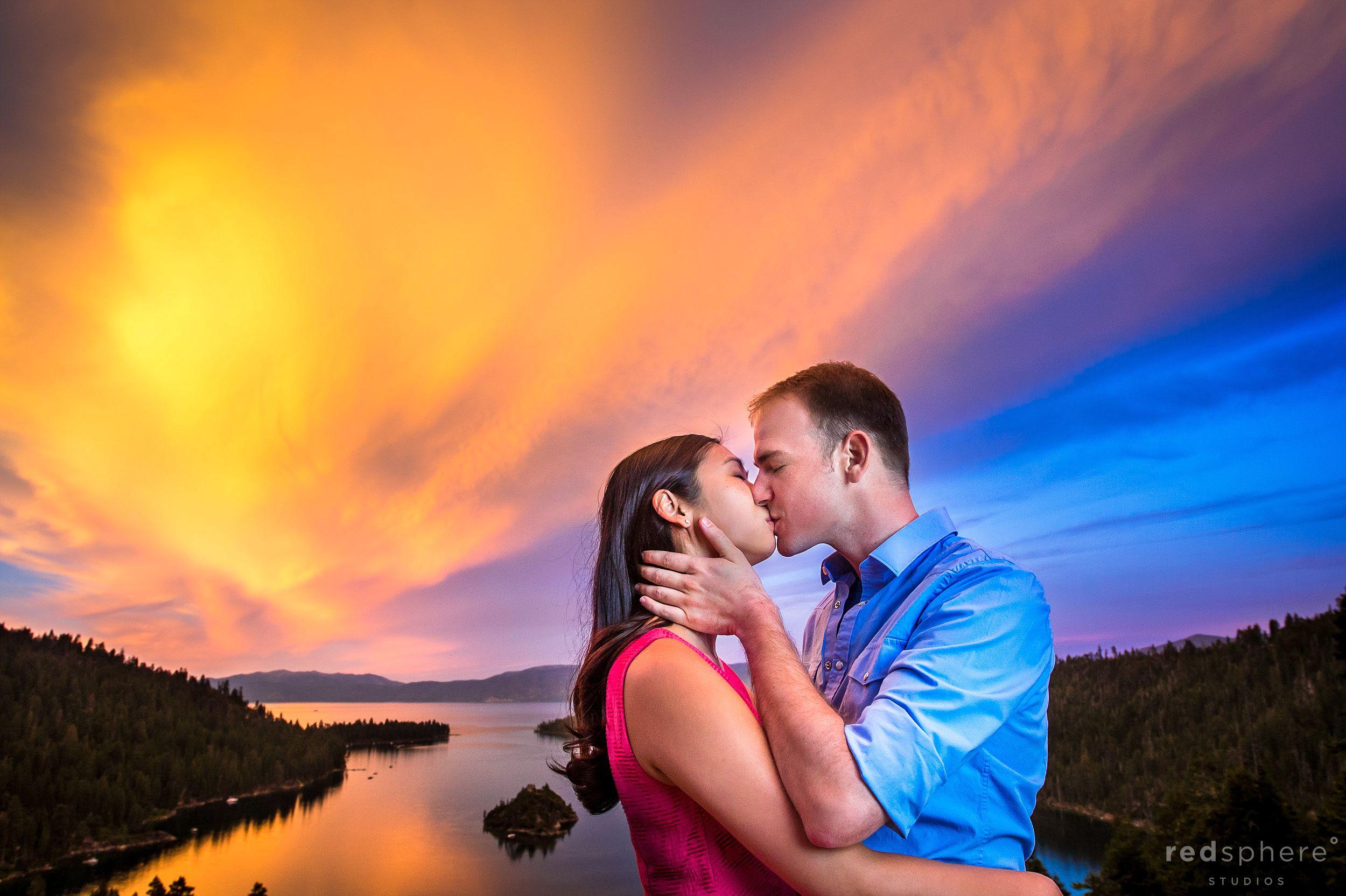 Couple Kiss Against Fiery Emerald Bay Lake Tahoe Sunset