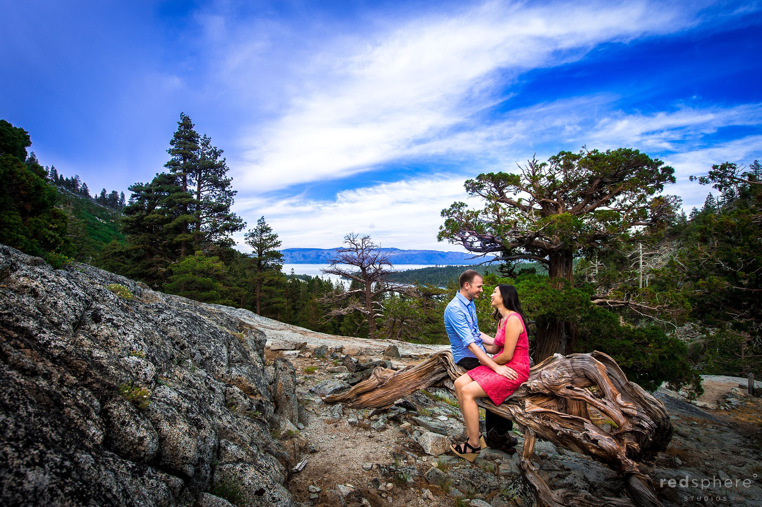 Couple Cozy Up on Rock, Lake Tahoe Engagements