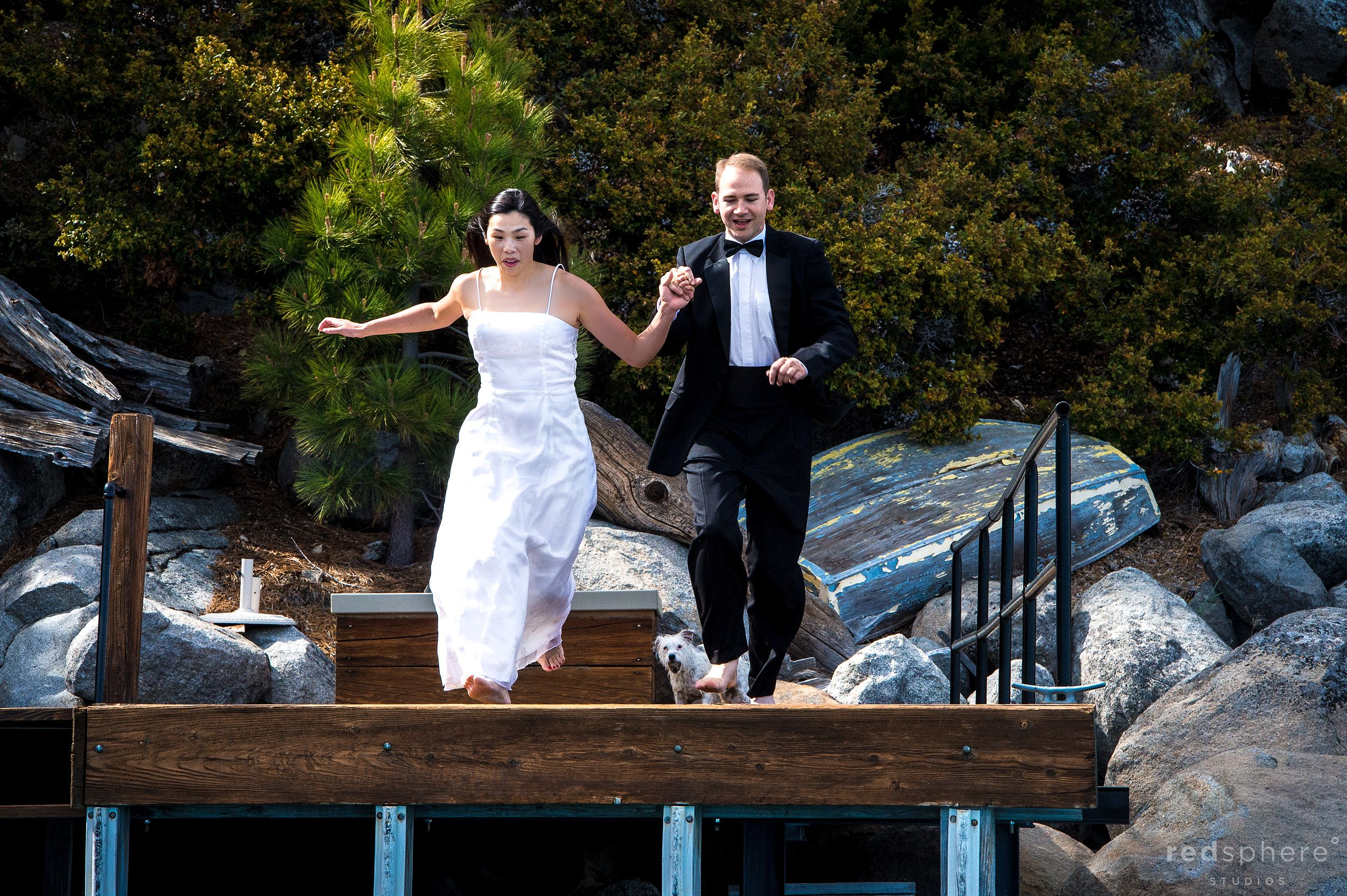 Couple Running Towards Edge of Dock Hand in Hand, Lake Tahoe