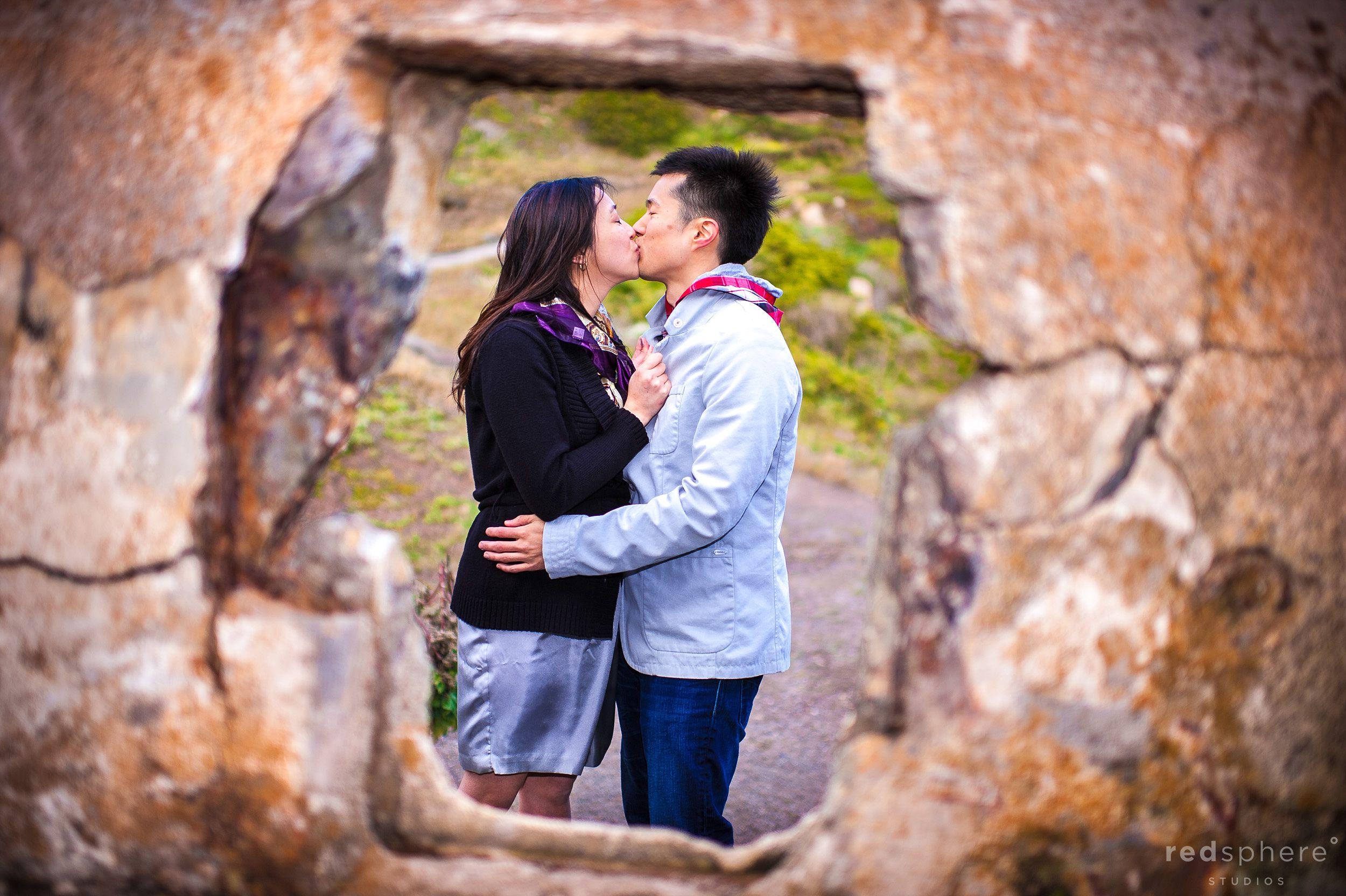 Couple Kiss Between Holes In Rocks, Sutro Bath Ruins