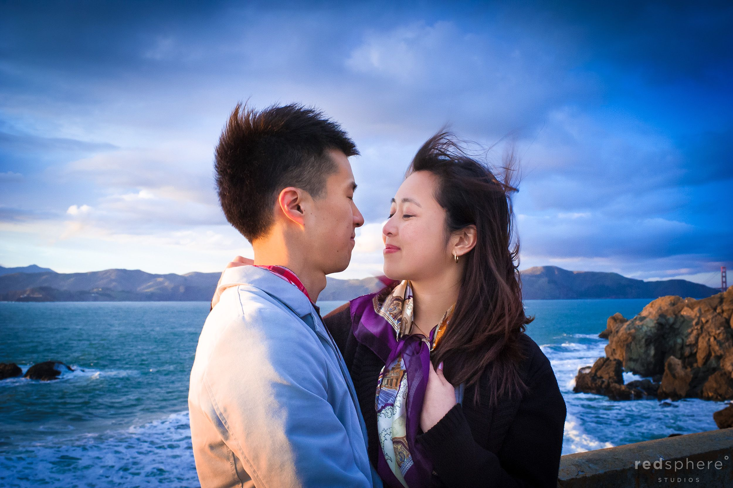 Couple Hold Each Other Tight Against San Francisco Winds, Sutro Bath/ Lands End Engagement