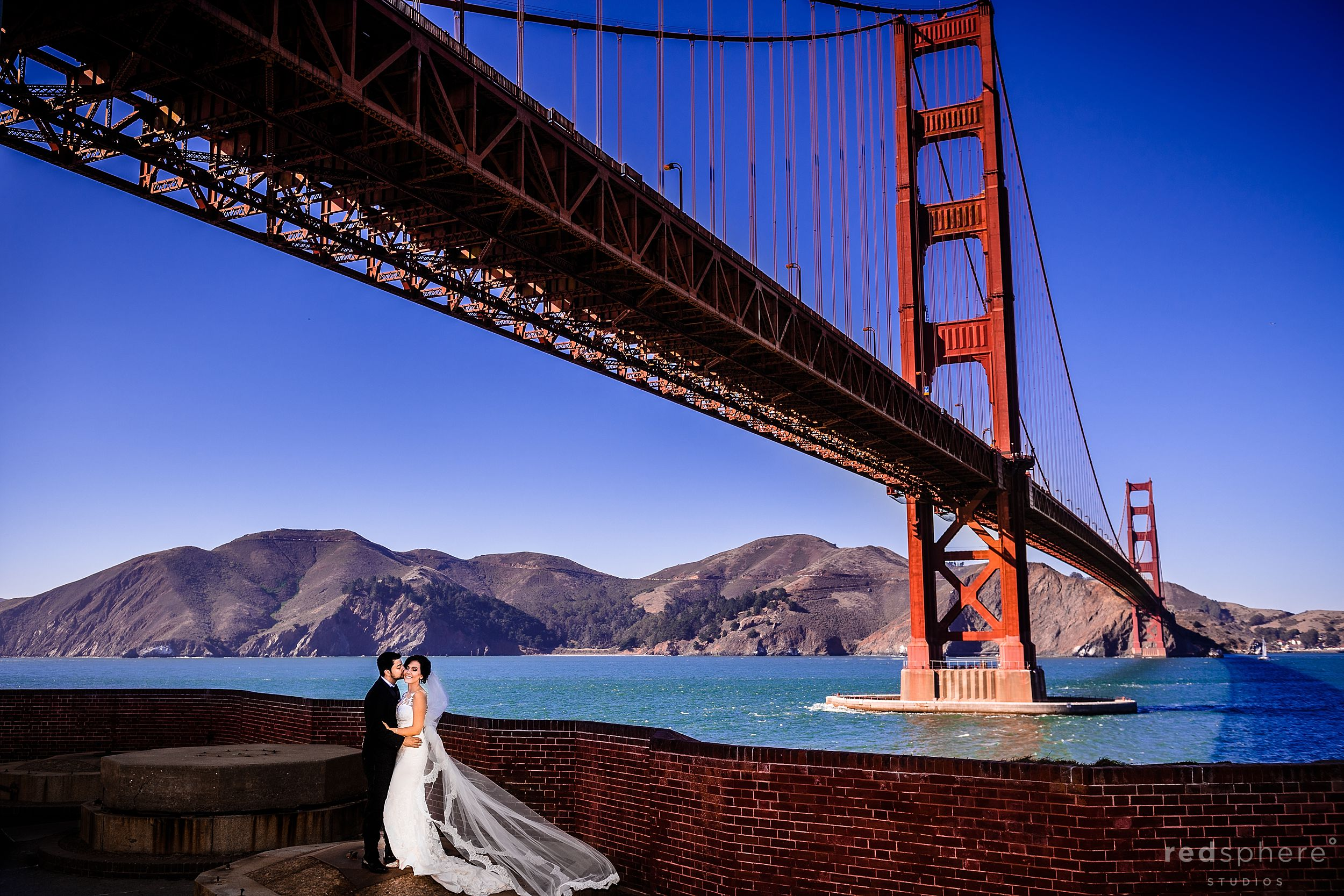 Wedding portrait in front of the Golden Gate Bridge San Francisco