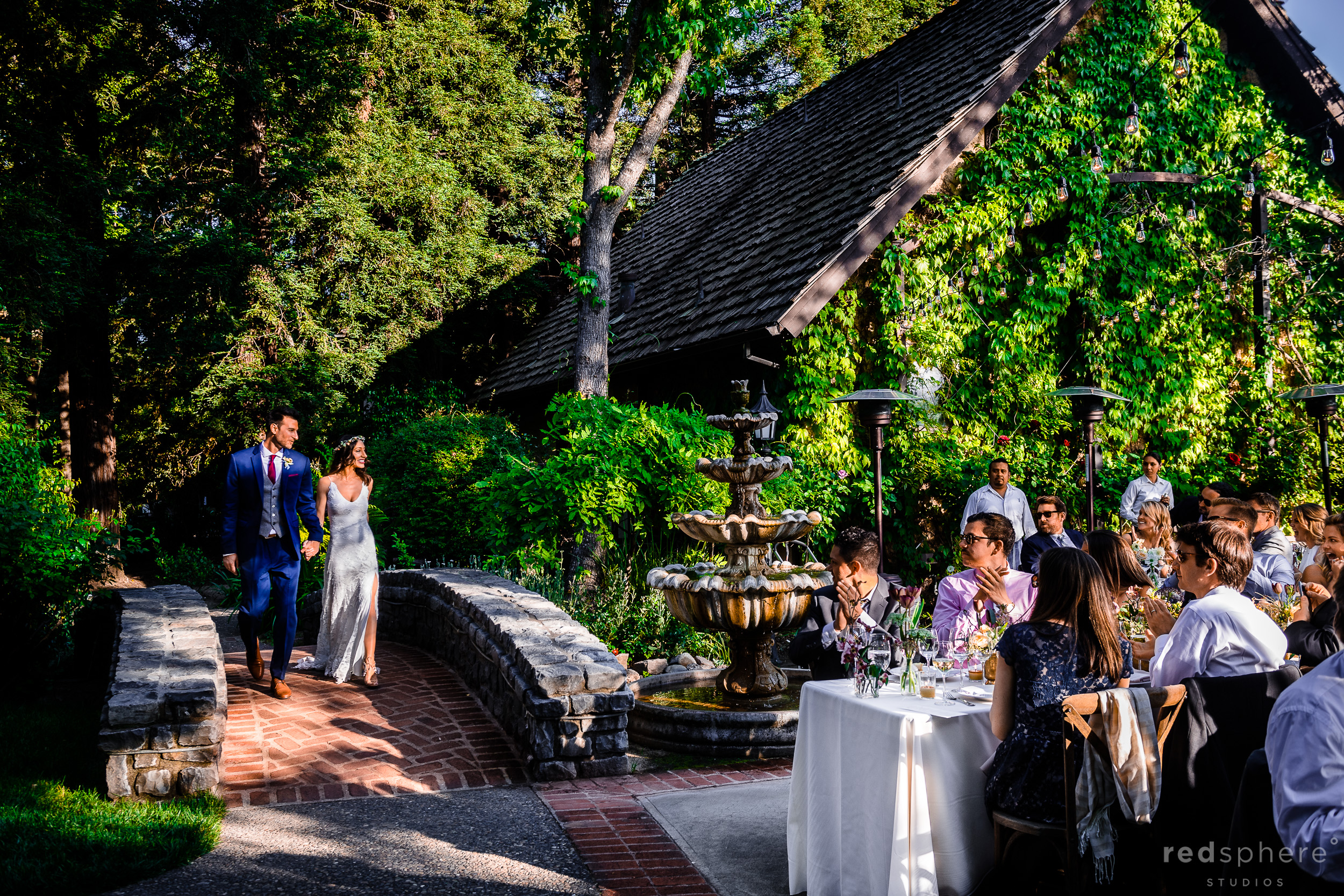 Bride and groom greeting guests at wedding reception. Harvest Inn By Charlie Palmer, St. Helena, Napa Valley