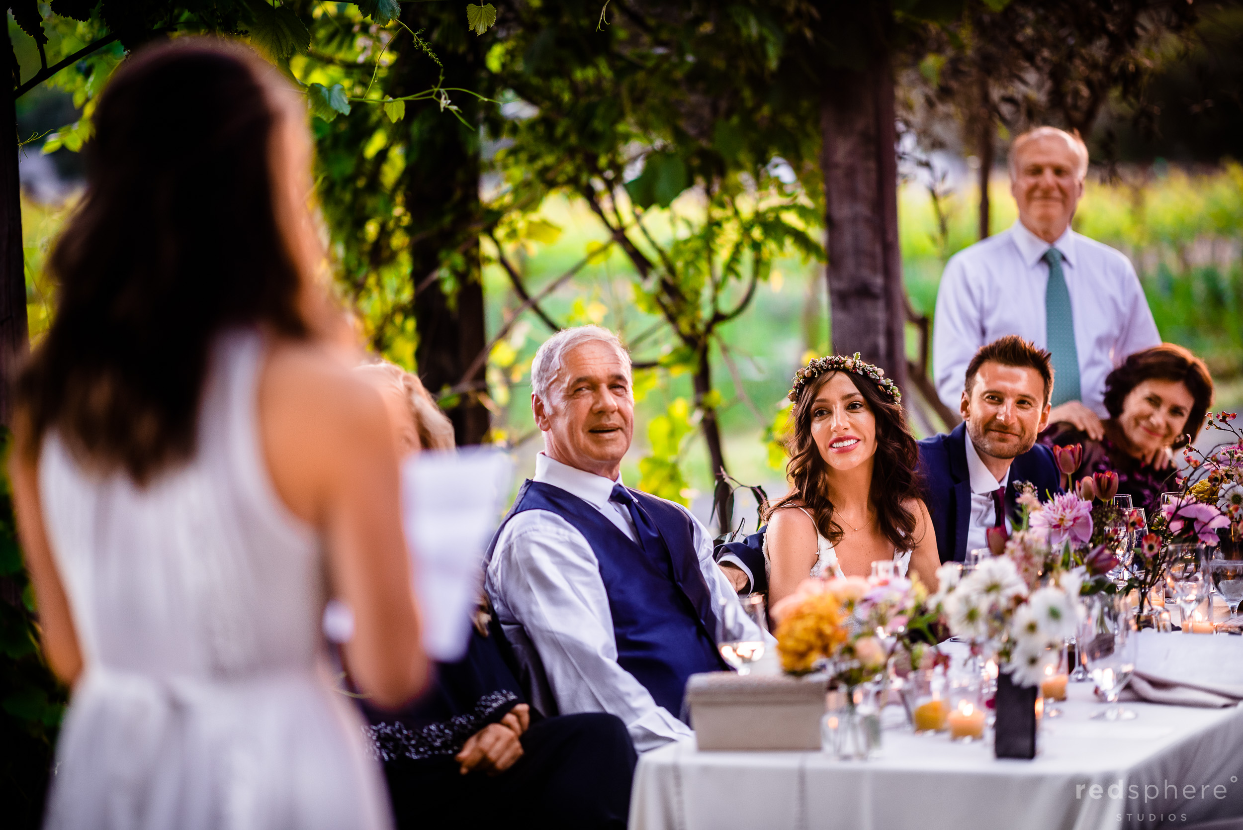 Wedding guests toasting bride and groom. Harvest Inn By Charlie Palmer, St. Helena, Napa Valley