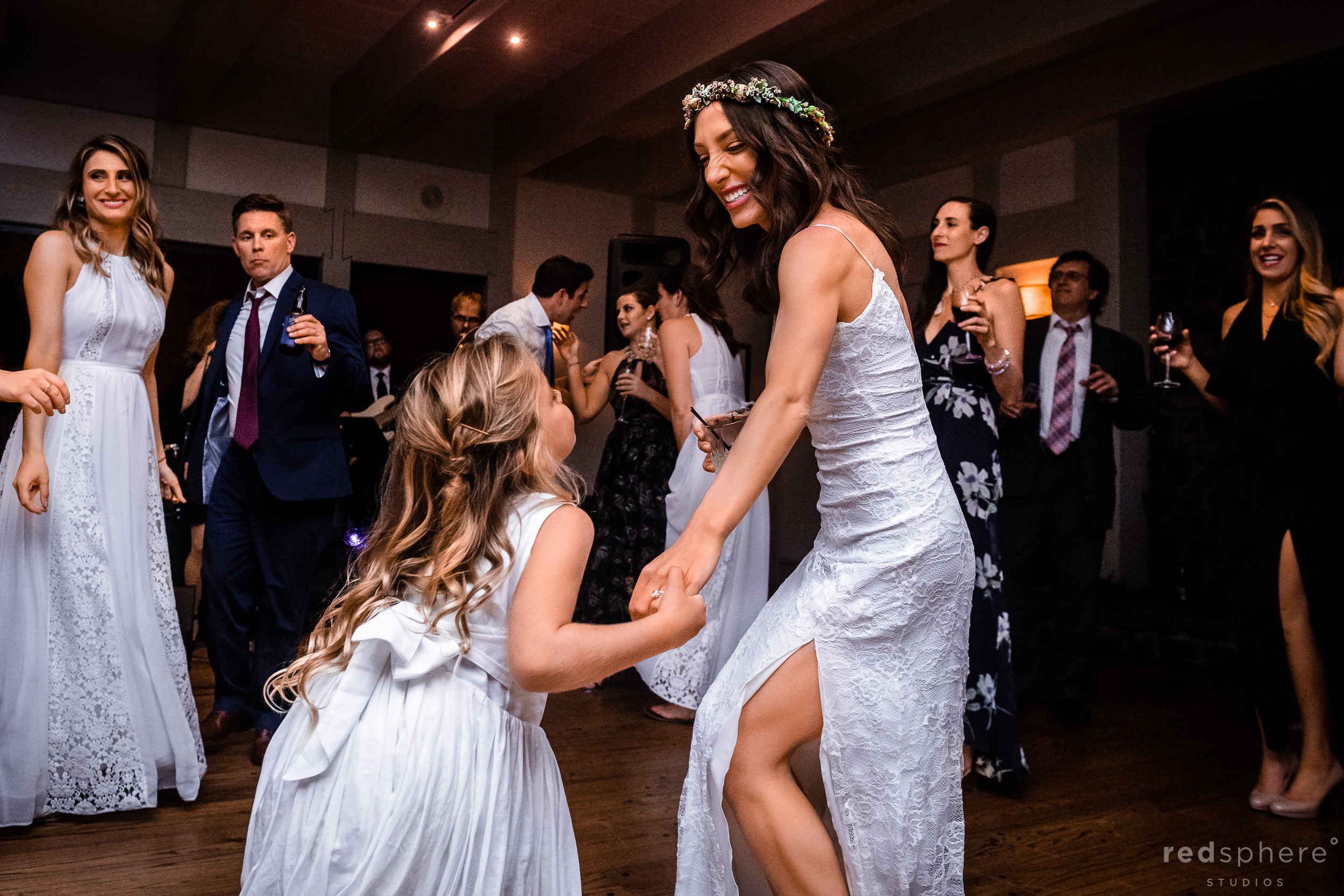 Wedding guests dancing during a wedding reception at Harvest Inn By Charlie Palmer, St. Helena, Napa Valley