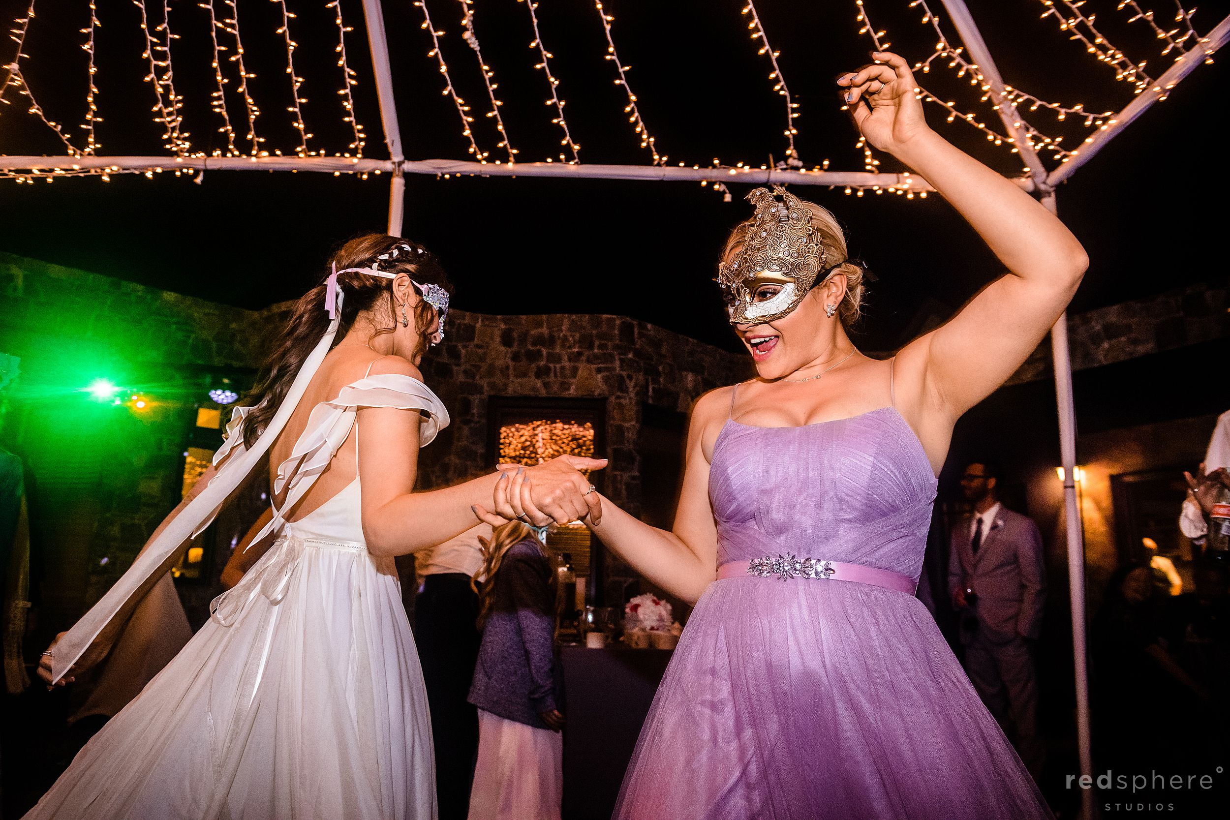 bride enjoying dance floor with sister during big sur reception