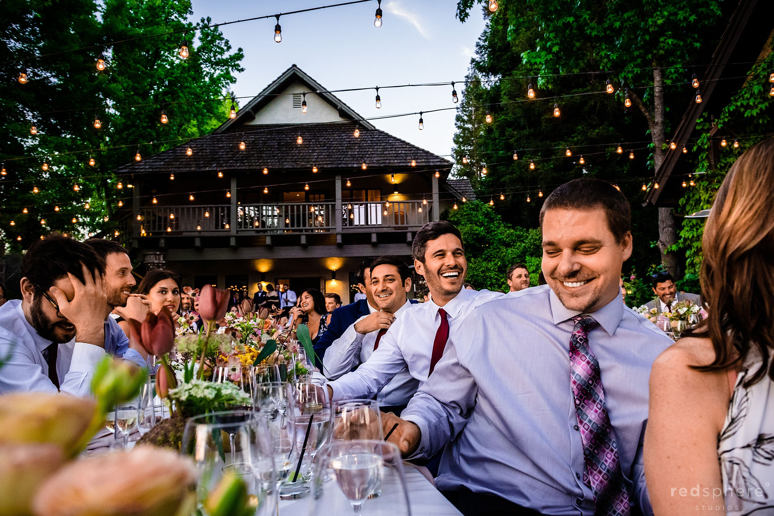 Wedding guests enjoying speeches at reception.  Harvest Inn By Charlie Palmer, St. Helena, Napa Valley