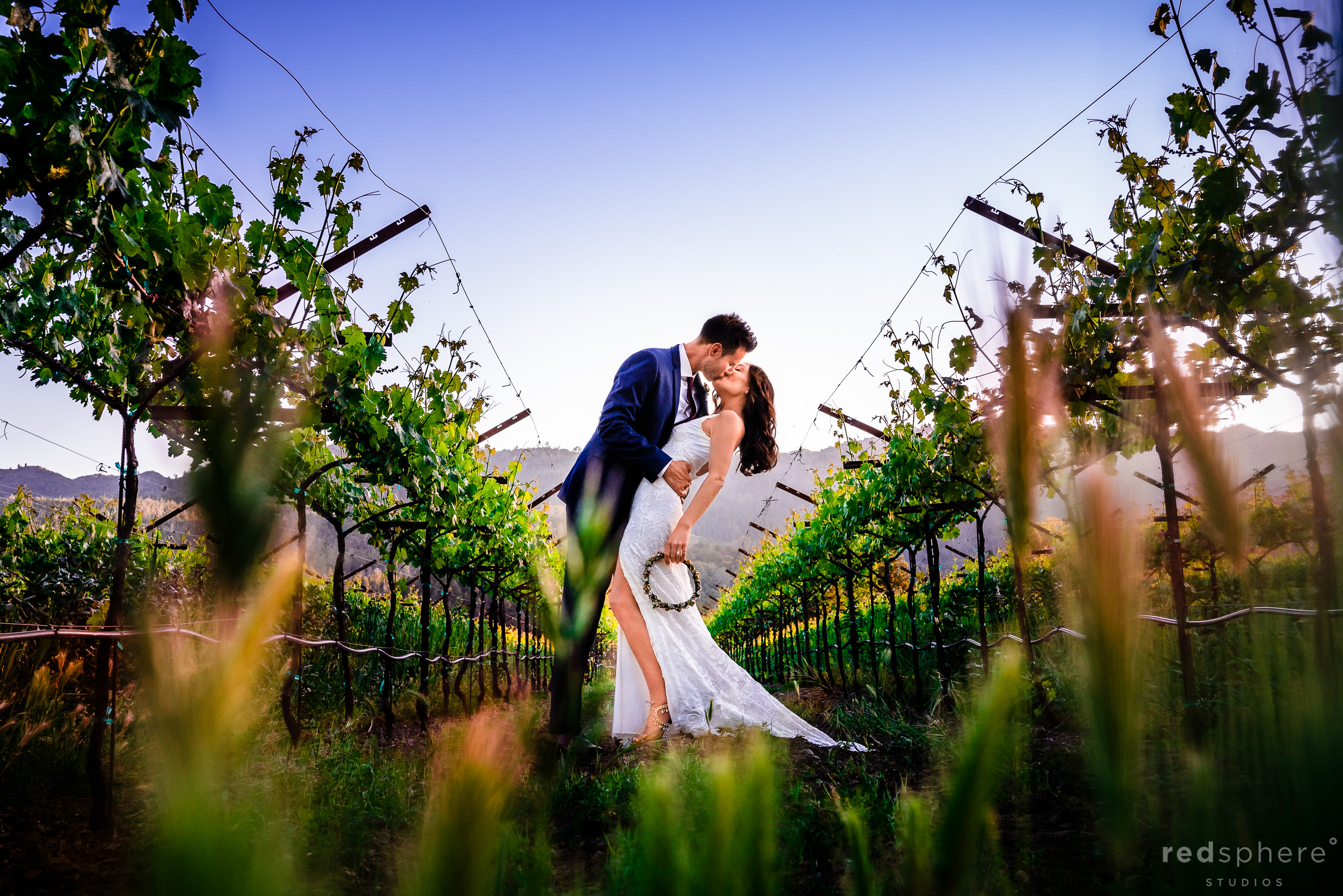 kiss wedding portrait at Harvest Inn By Charlie Palmer, St. Helena, Napa Valley, Bohemian Lace Wedding Dress from Grace Loves Lace