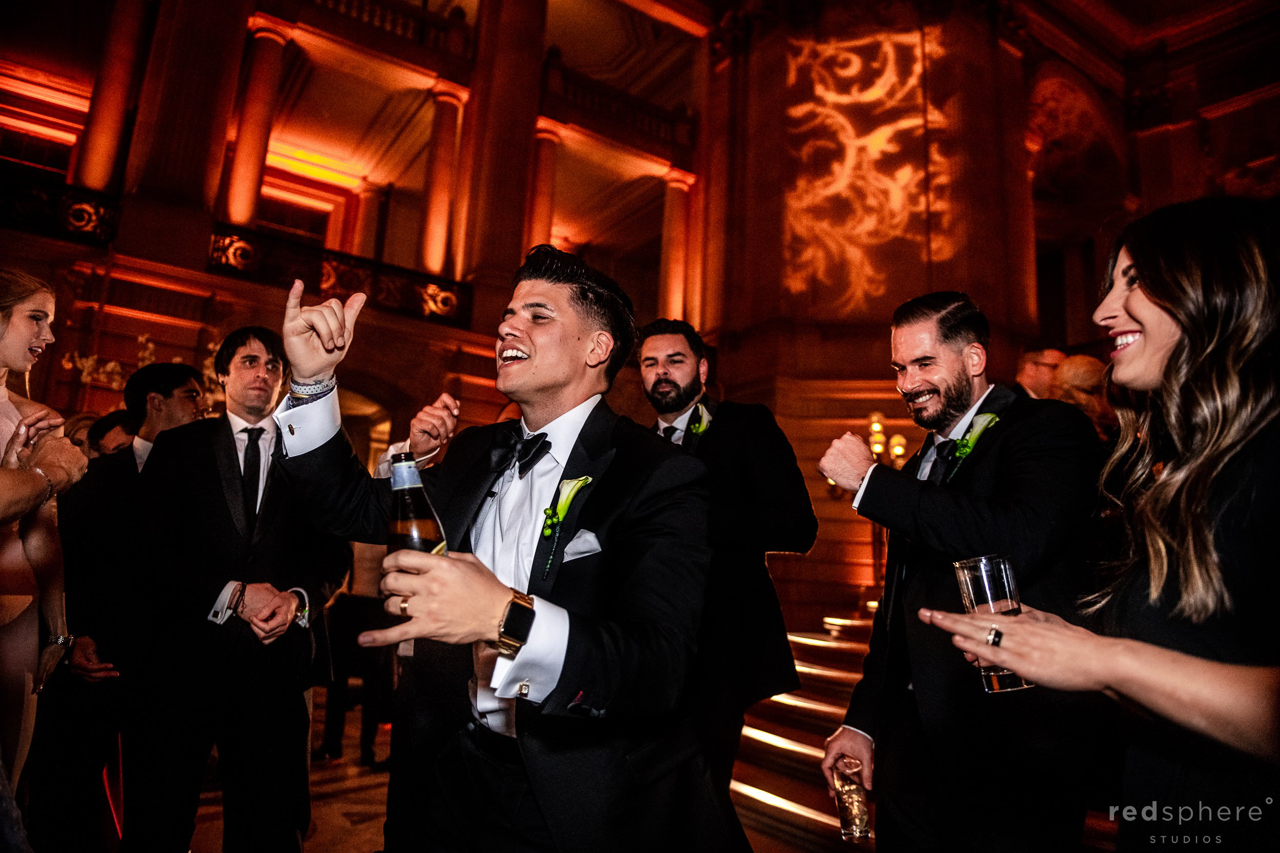 Groom dancing with guests at San Francisco City Hall dance floor