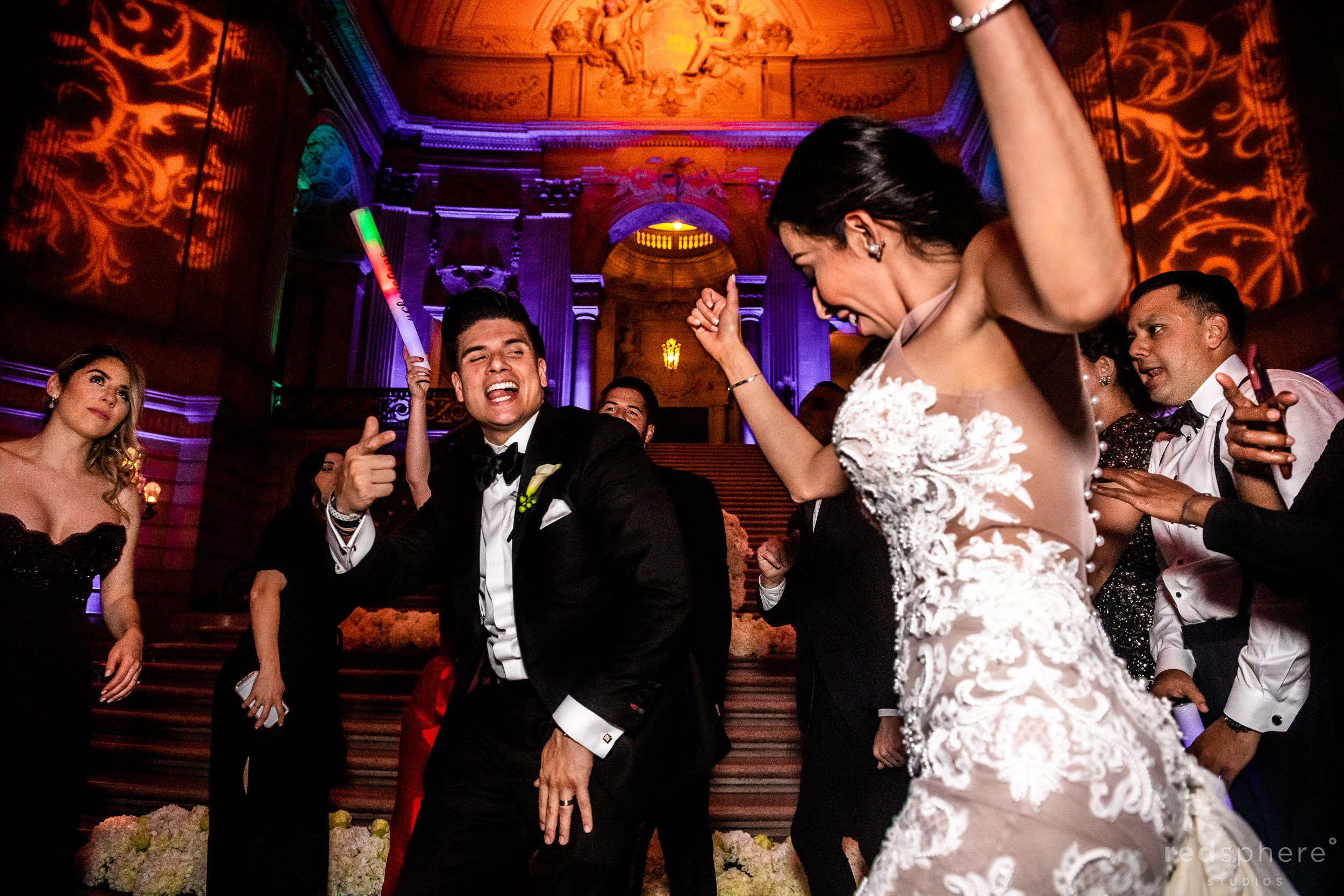 Bride and groom dancing with guests at San Francisco City Hall dance floor