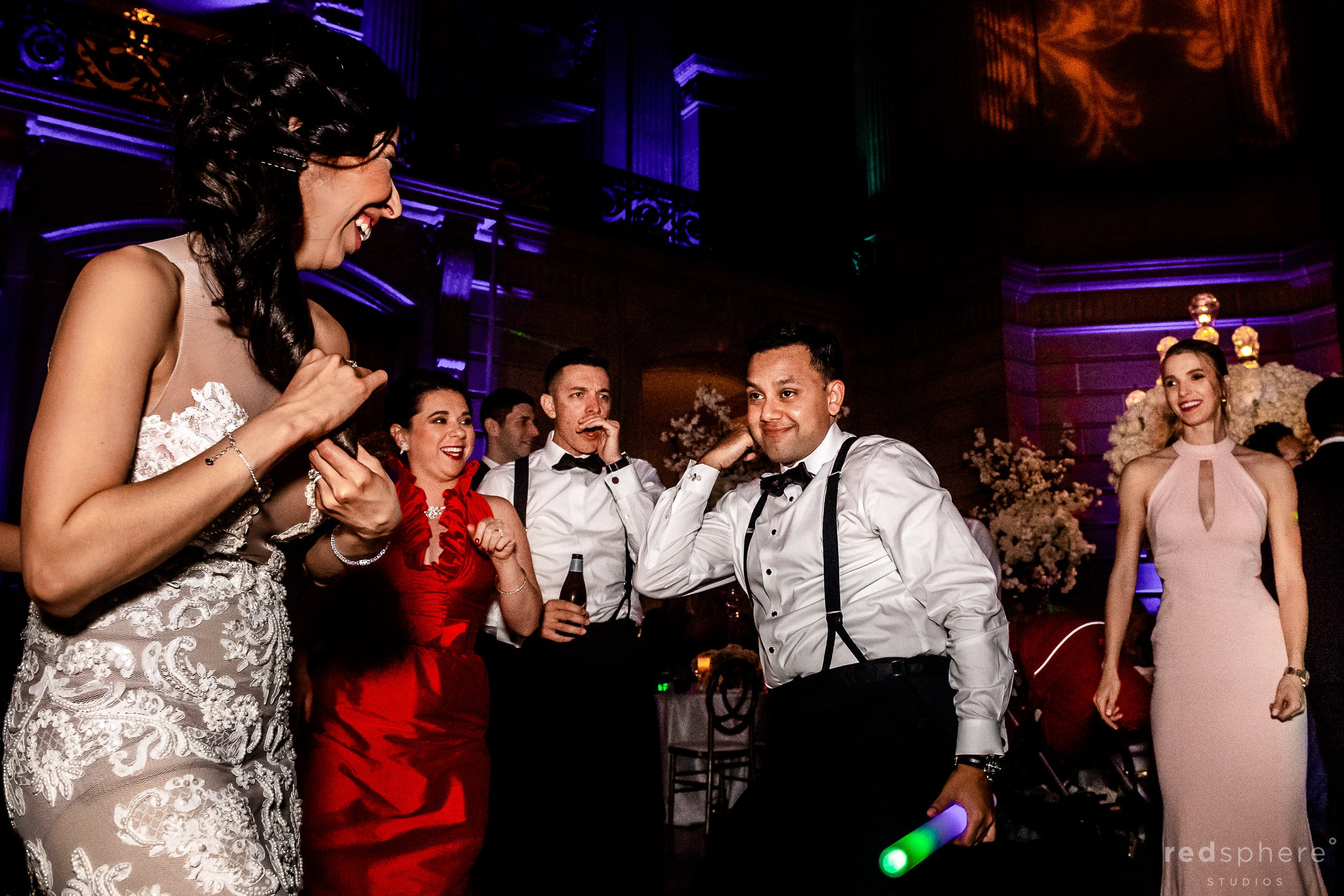 Bride dancing with guests at San Francisco City Hall dance floor