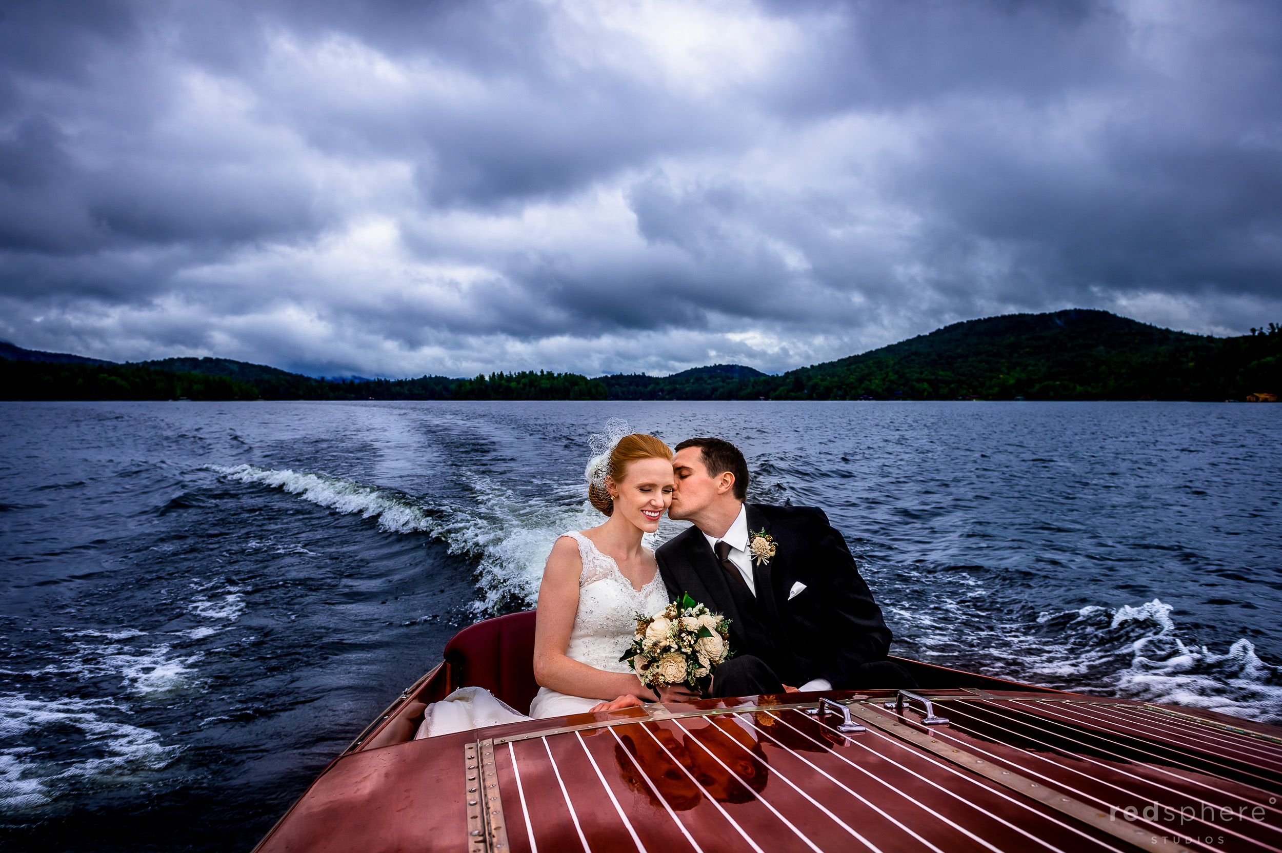 Groom Giving Broom His Jacket on a Boat at Saranac Lake New York